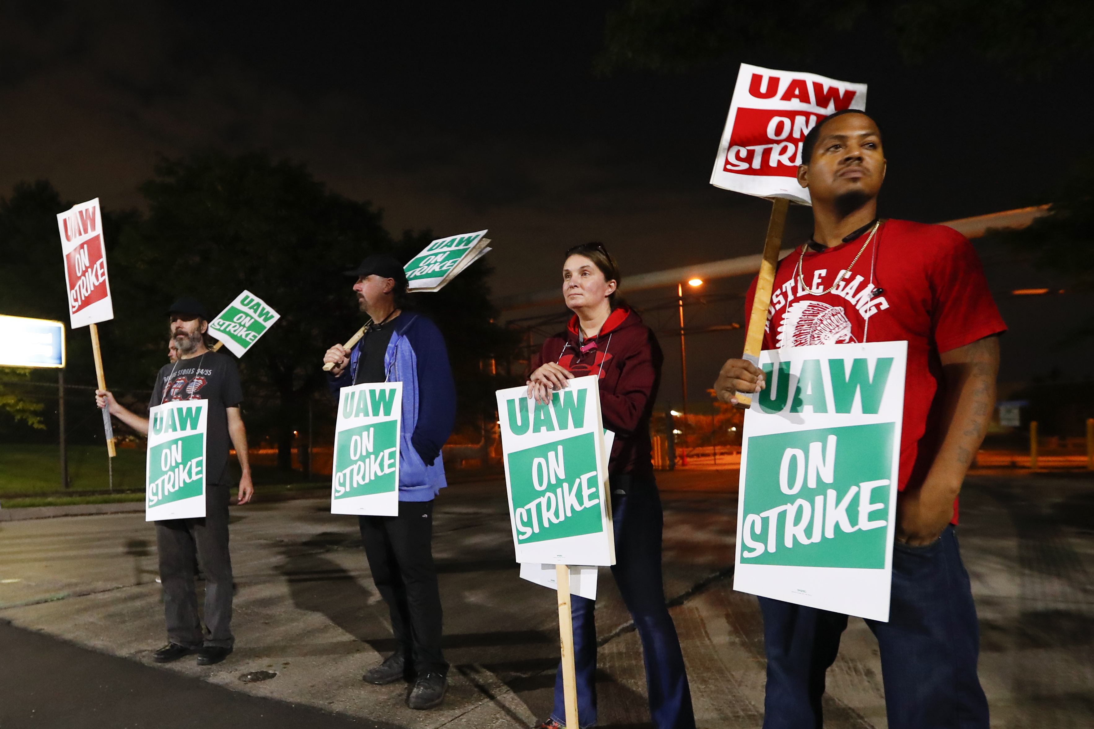 United Auto Workers members picket outside the General Motors assembly plant in Hamtramck, Mich., on Monday.