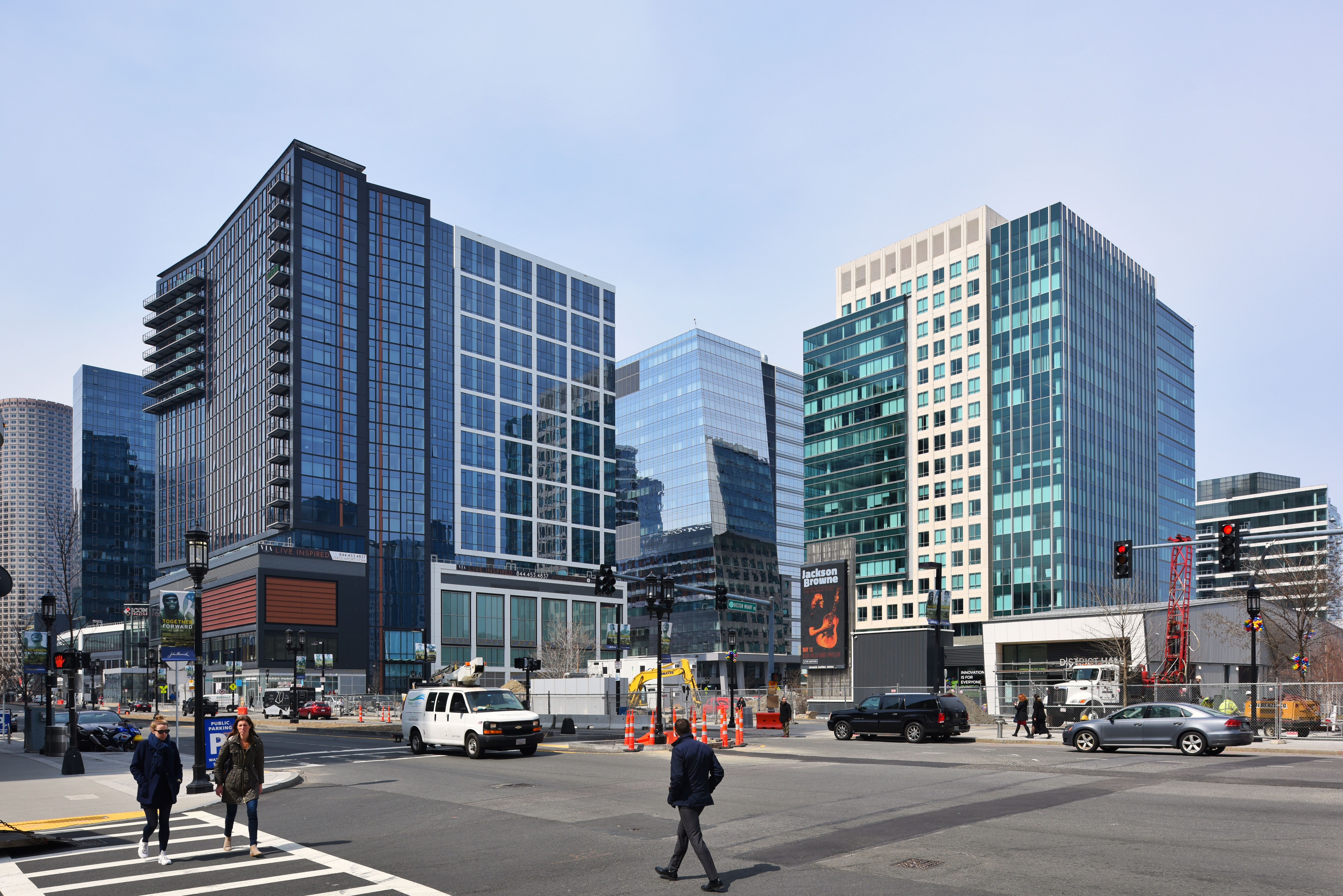 Glassy buildings in a busy business district.