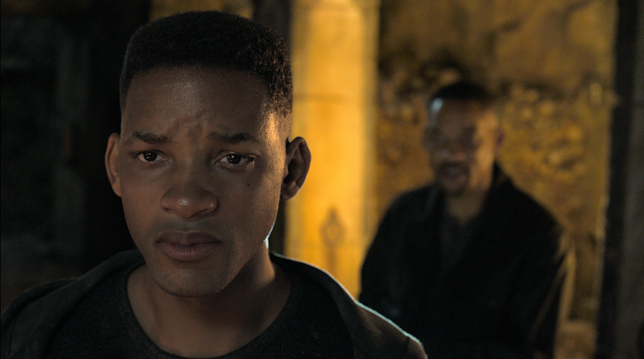 a young will smith stands with his back turned to his present day self