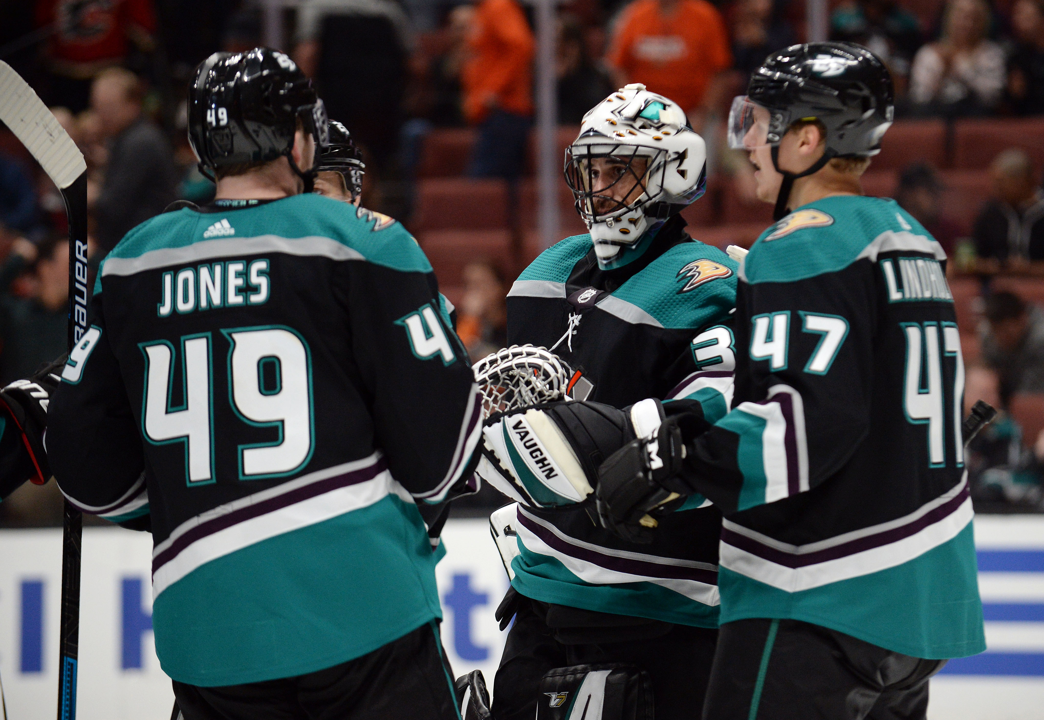 April 3, 2019; Anaheim, CA, USA; Anaheim Ducks goaltender Ryan Miller (30) celebrates the 3-1 victory with left wing Max Jones (49) and defenseman Hampus Lindholm (47) against the Calgary Flames at Honda Center.