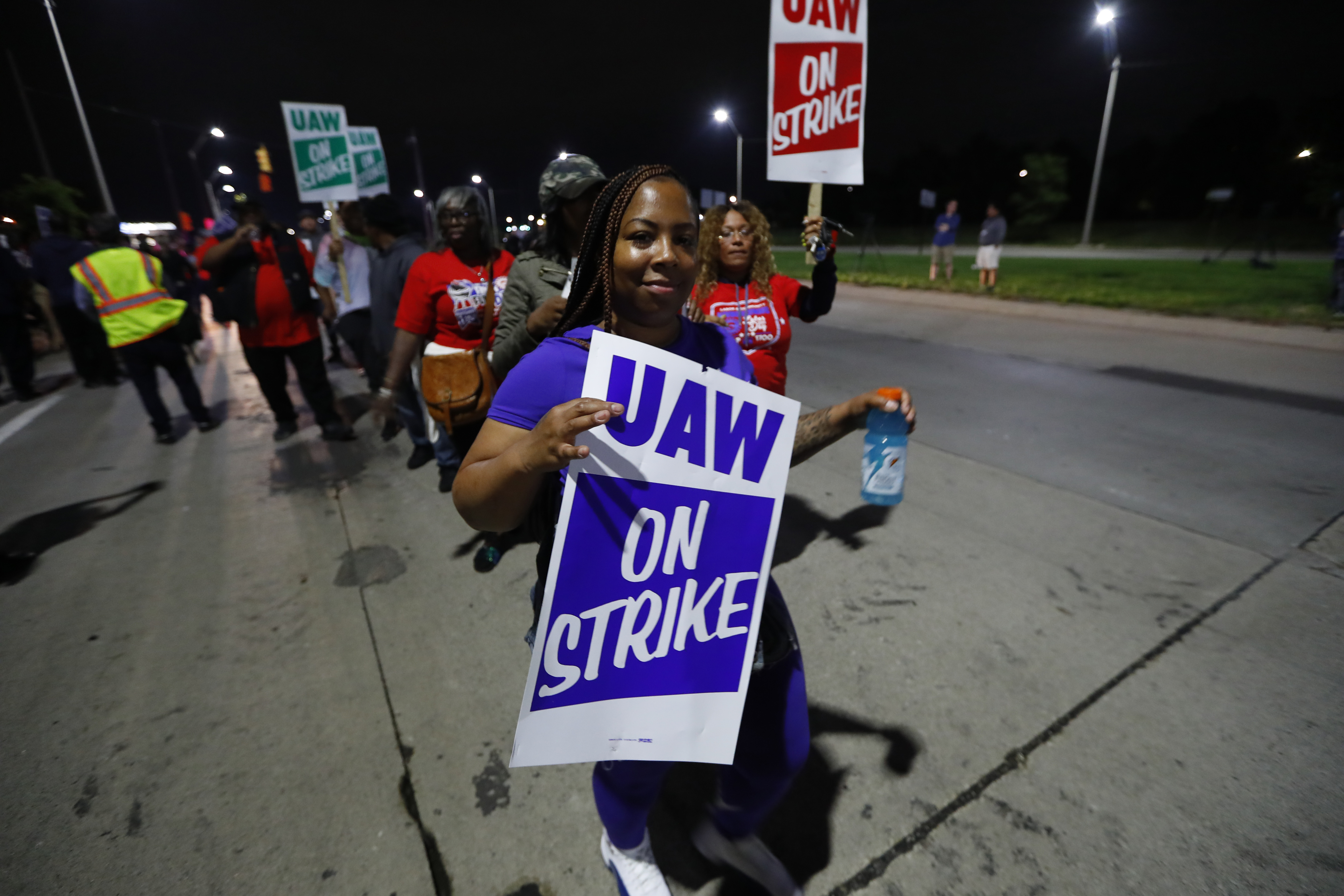 United Auto Workers members picket outside the General Motors assembly plant in Hamtramck, Mich., early Monday.