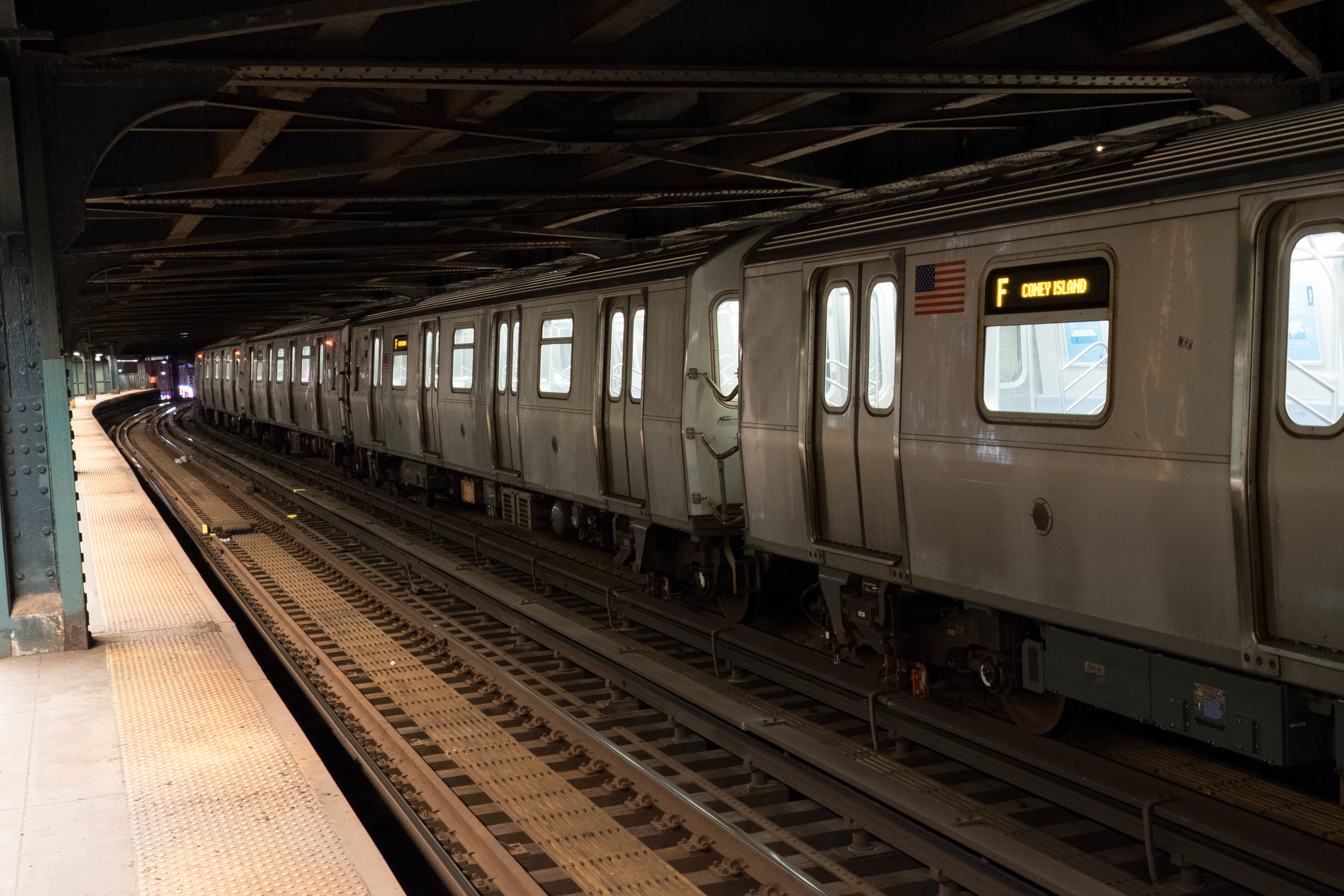 An F train running underground in the NYC subway system.