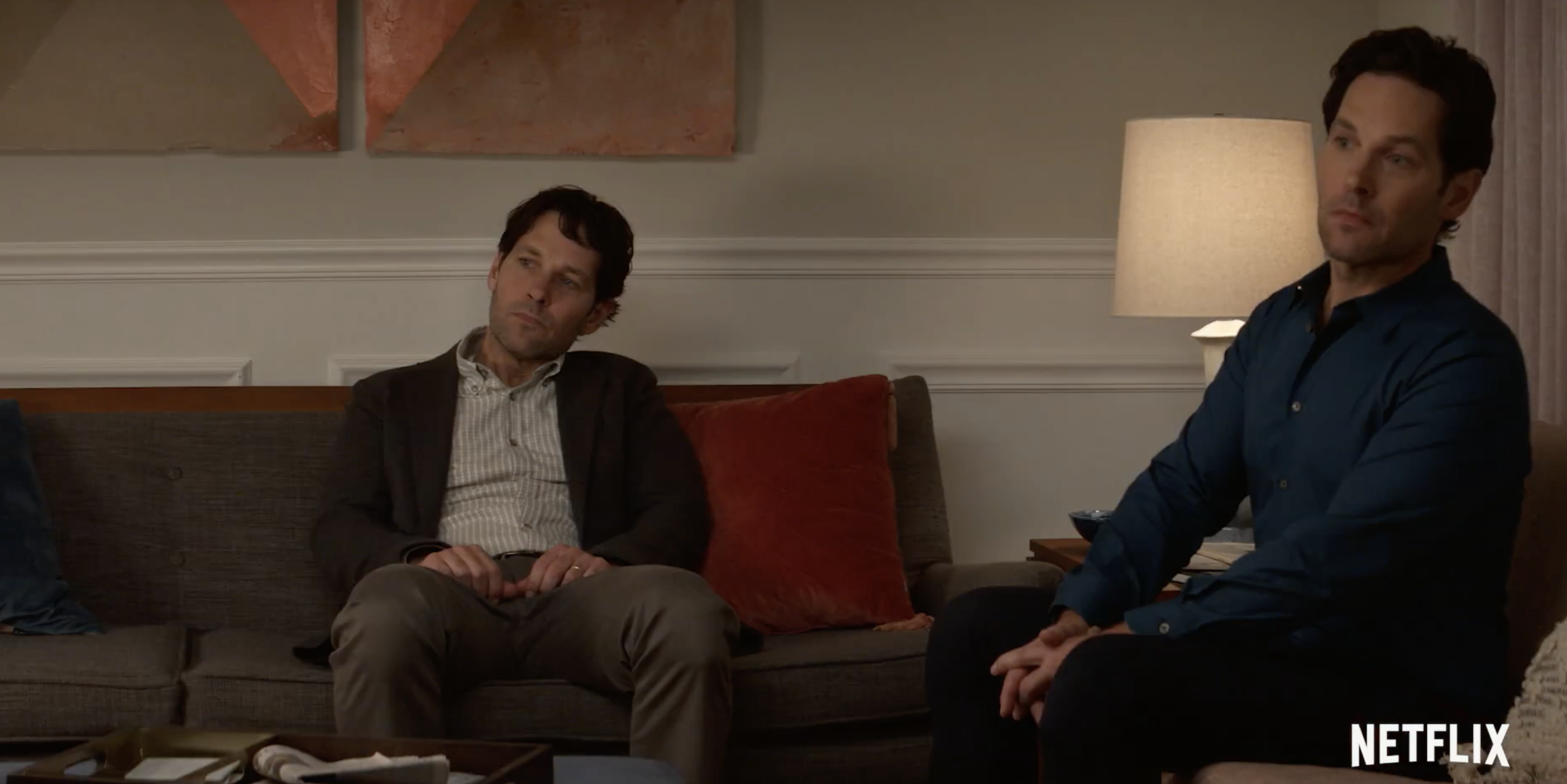 two paul rudds, chilling on a couch, five feet apart 'cuz they're the same guy