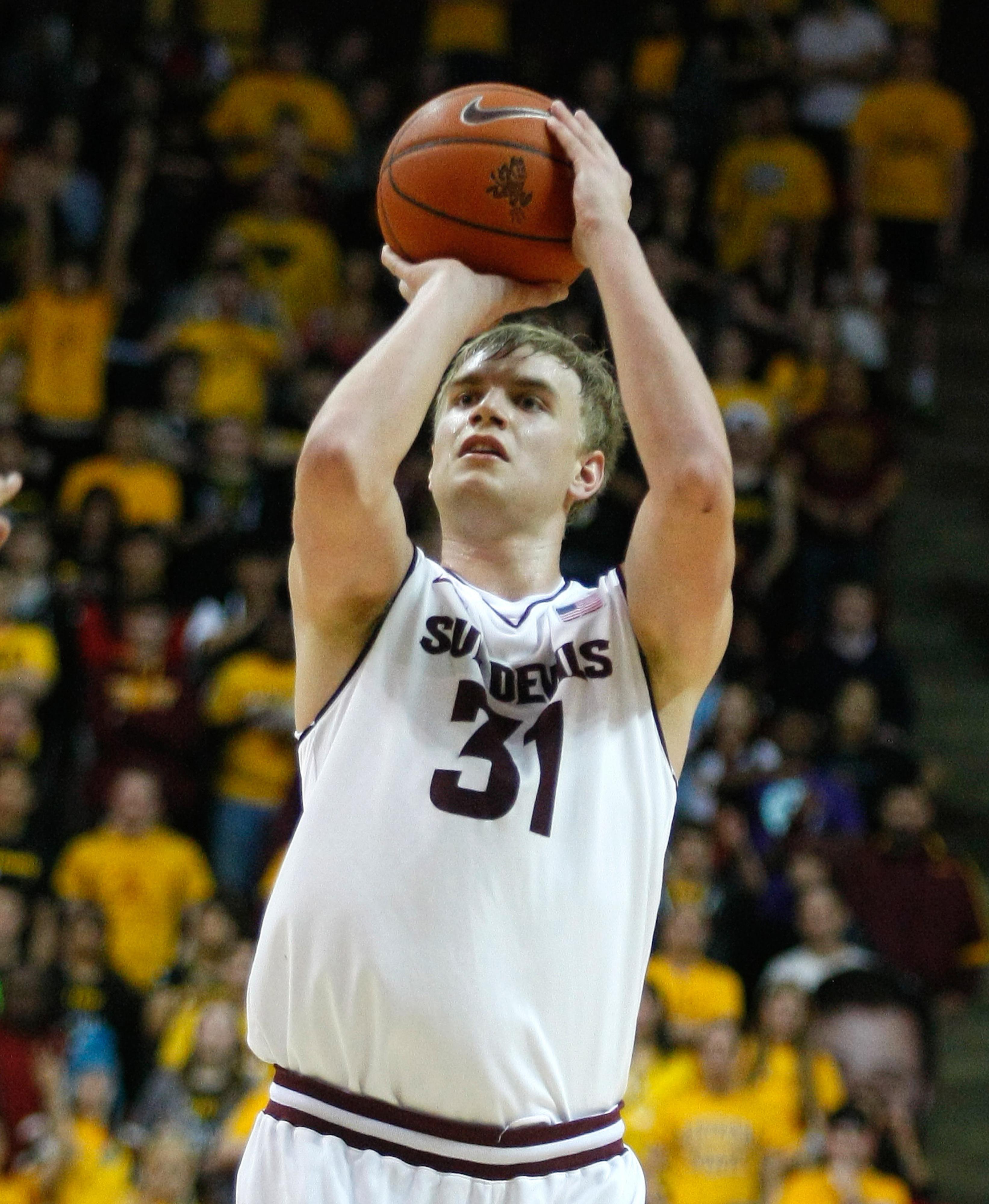 Arizona State forward Jon Gilling launches a three-pointer