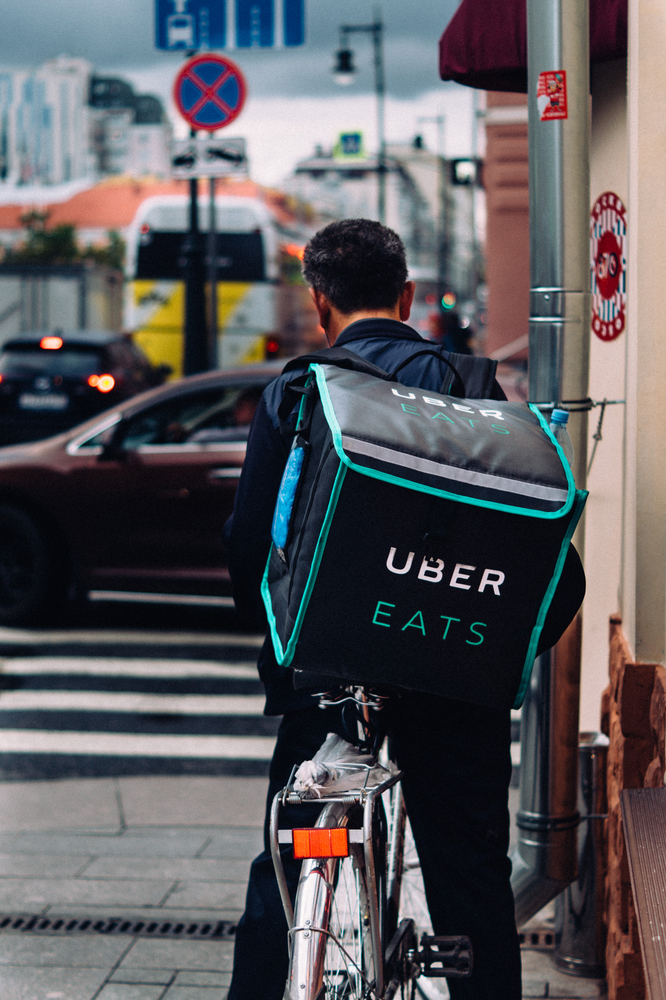 Uber Eats food delivery services bicycle rider in the street.