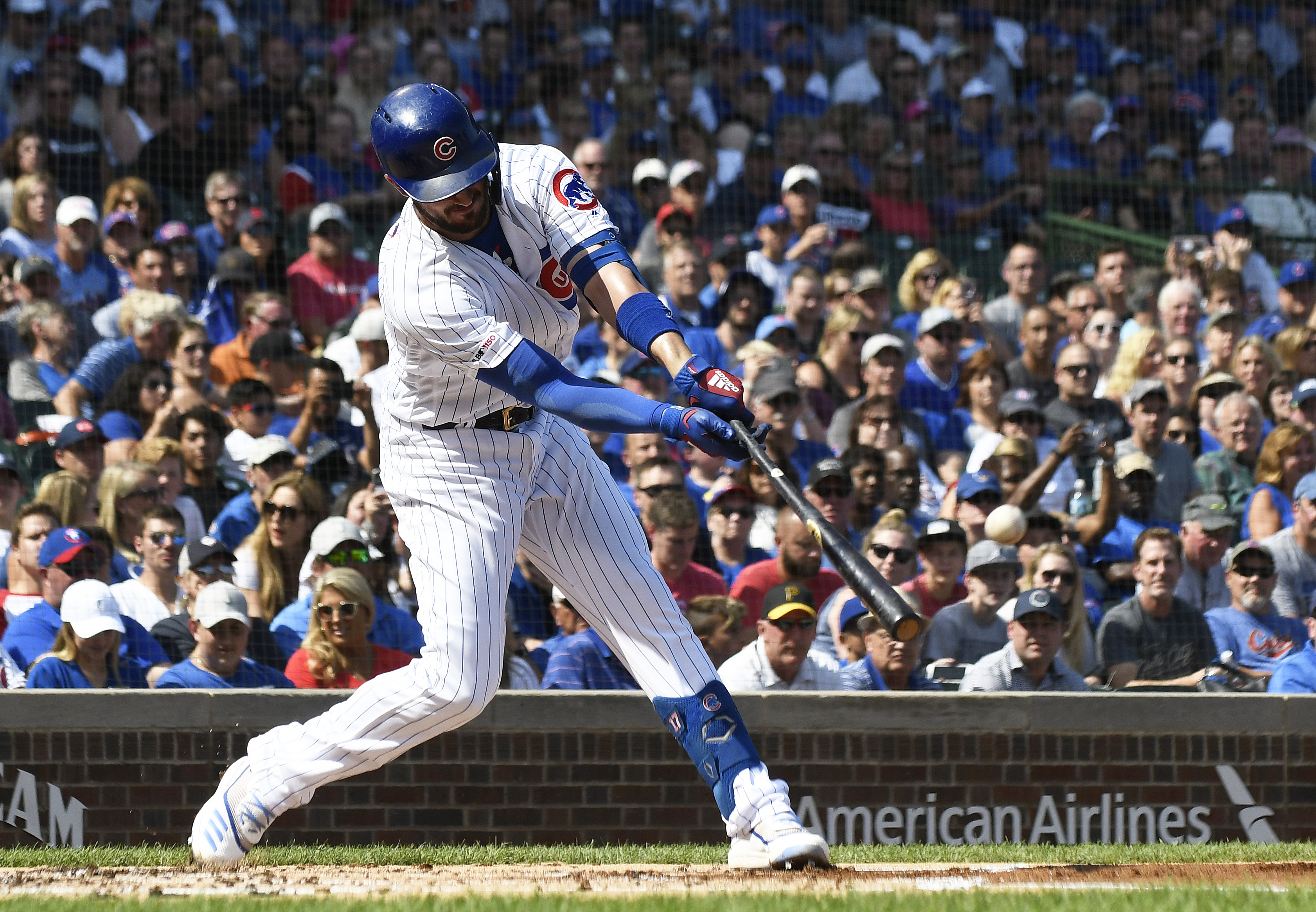 The Cubs' Kris Bryant hits the first of his two home runs Sunday against the Pirates at Wrigley Field.