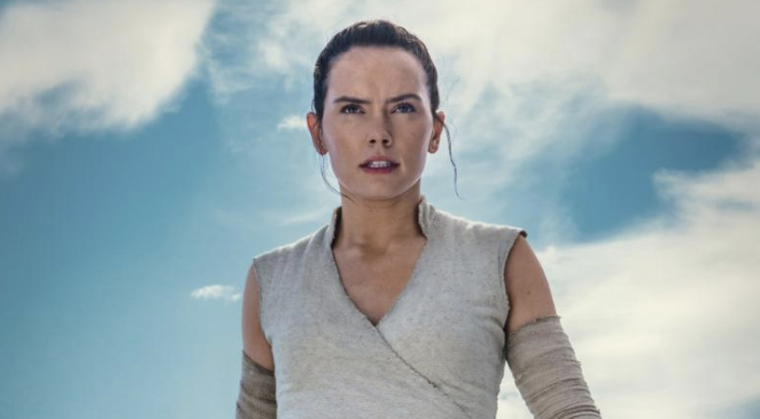 "Rey is back with a lightsaber in her new photo for ""Rise of Skywalker."""