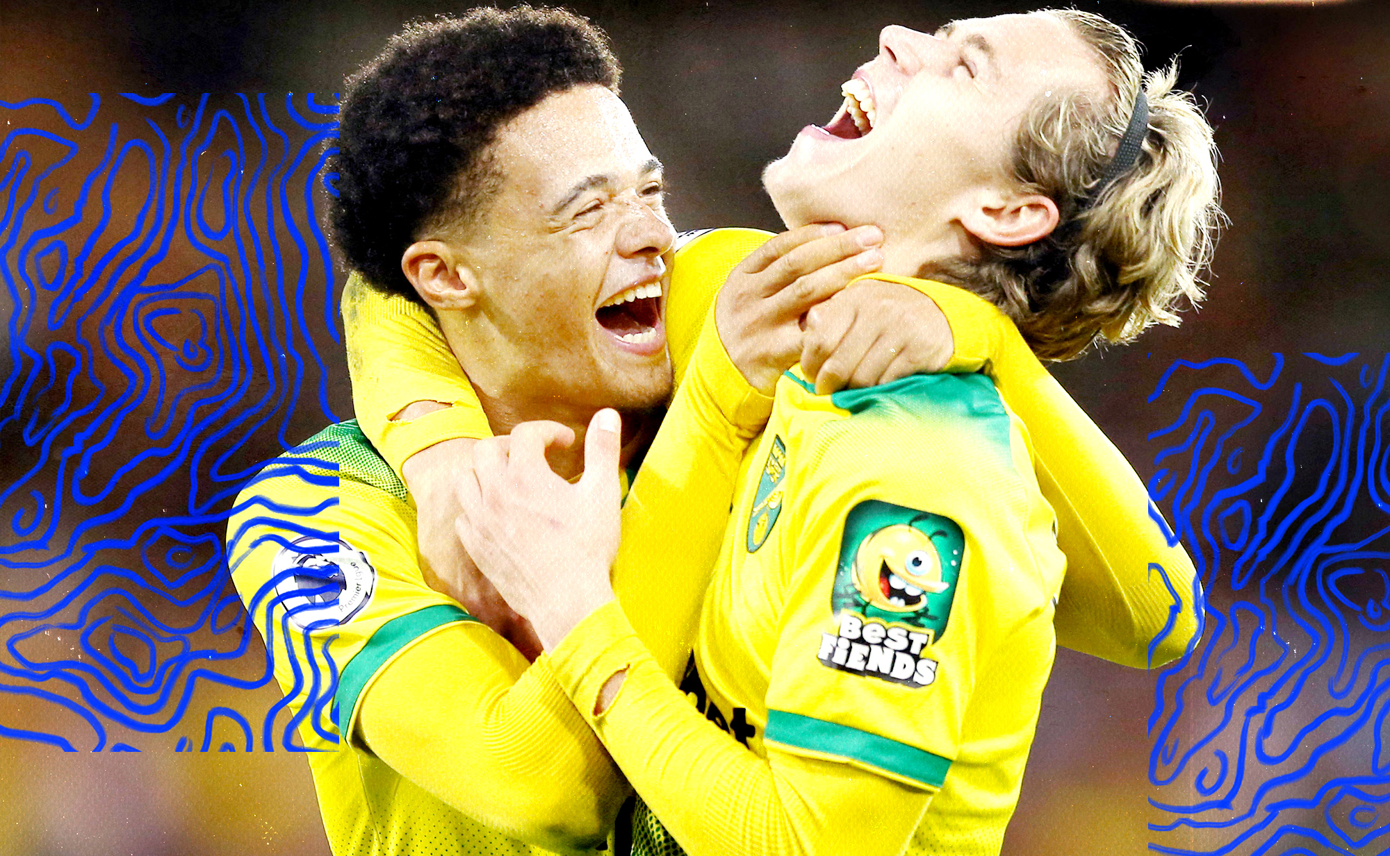 Norwich City's Todd Cantwell and Jamal Lewis celebrate a victory with a hug.