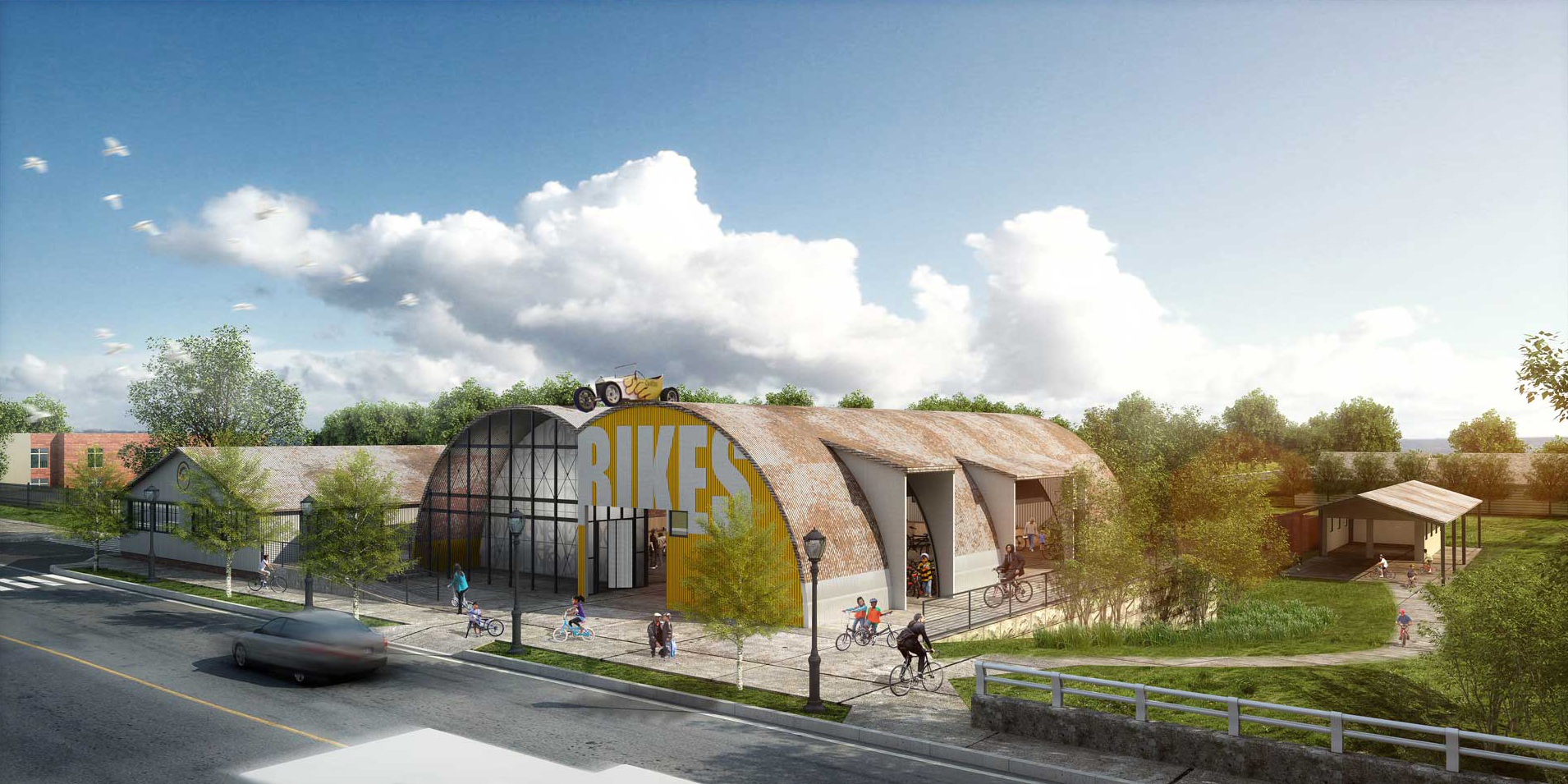 """A rendering of an aging hangar restored with a new yellow paint job on the front and white letters that say, """"BIKES."""""""