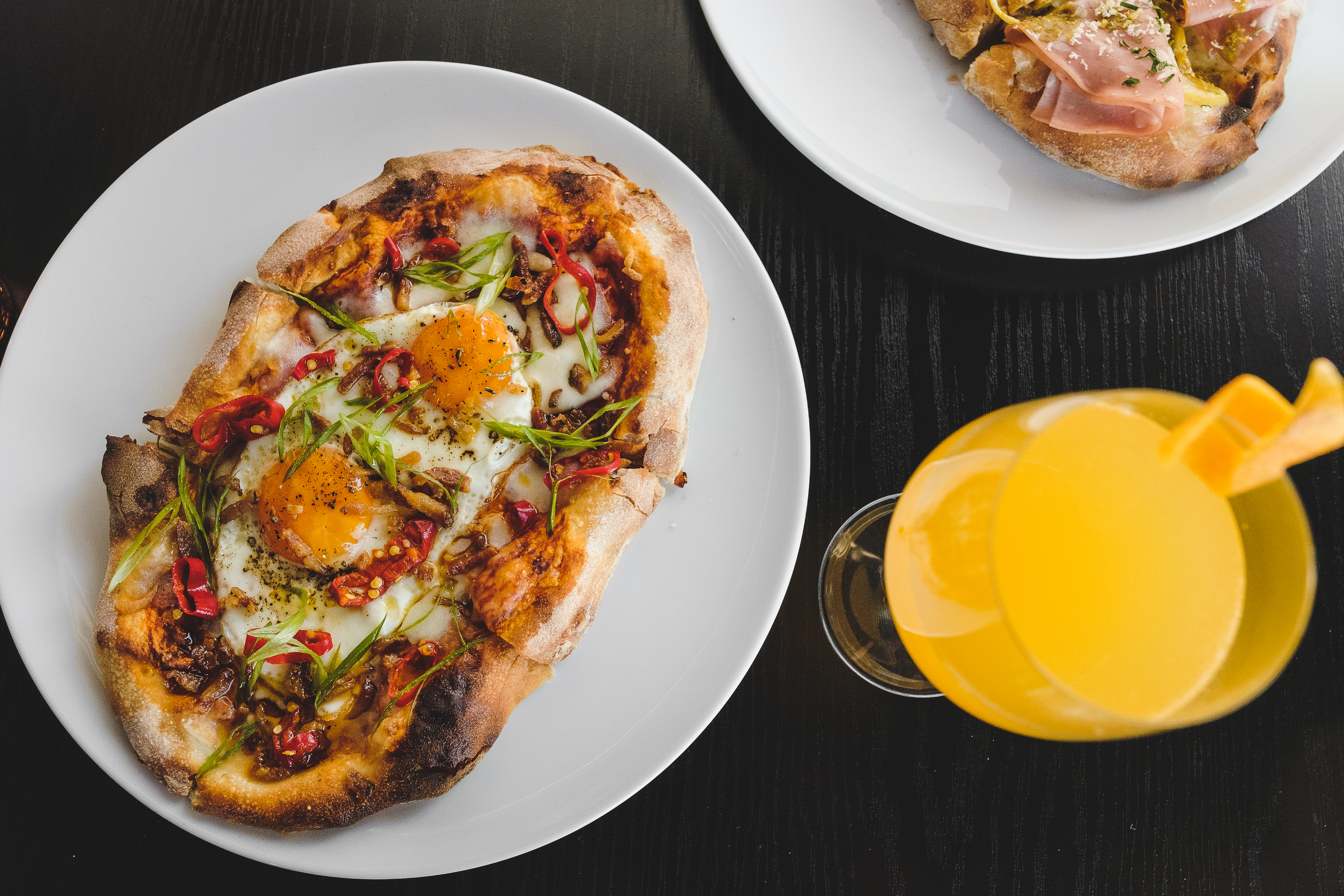 Pane frattau pizza with sunny-side-up eggs, guanciale, and chili