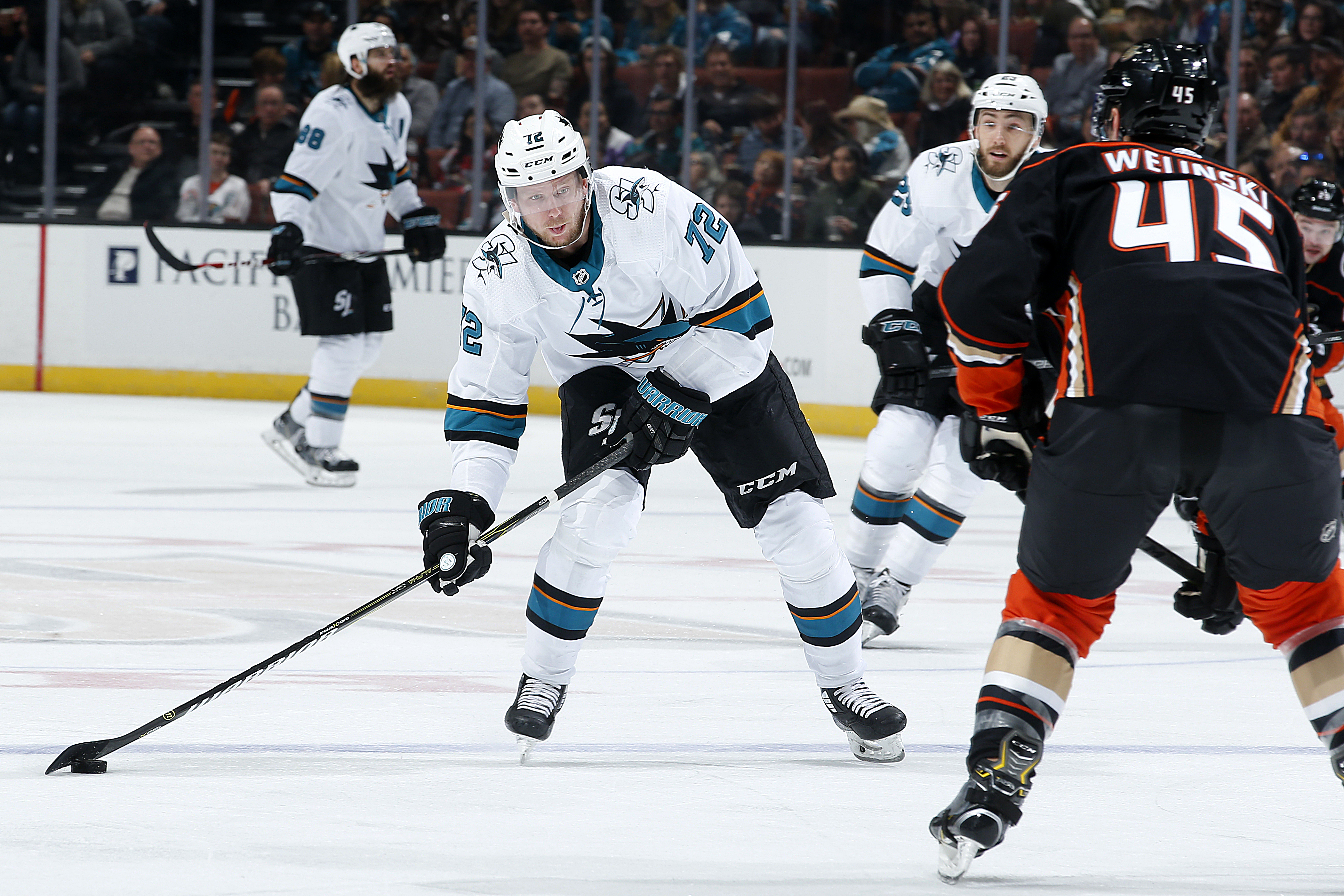 Tim Heed of the San Jose Sharks winds up for a shot with pressure from Andy Welinski of the Anaheim Ducks during the game on March 22, 2019 at Honda Center in Anaheim, California.