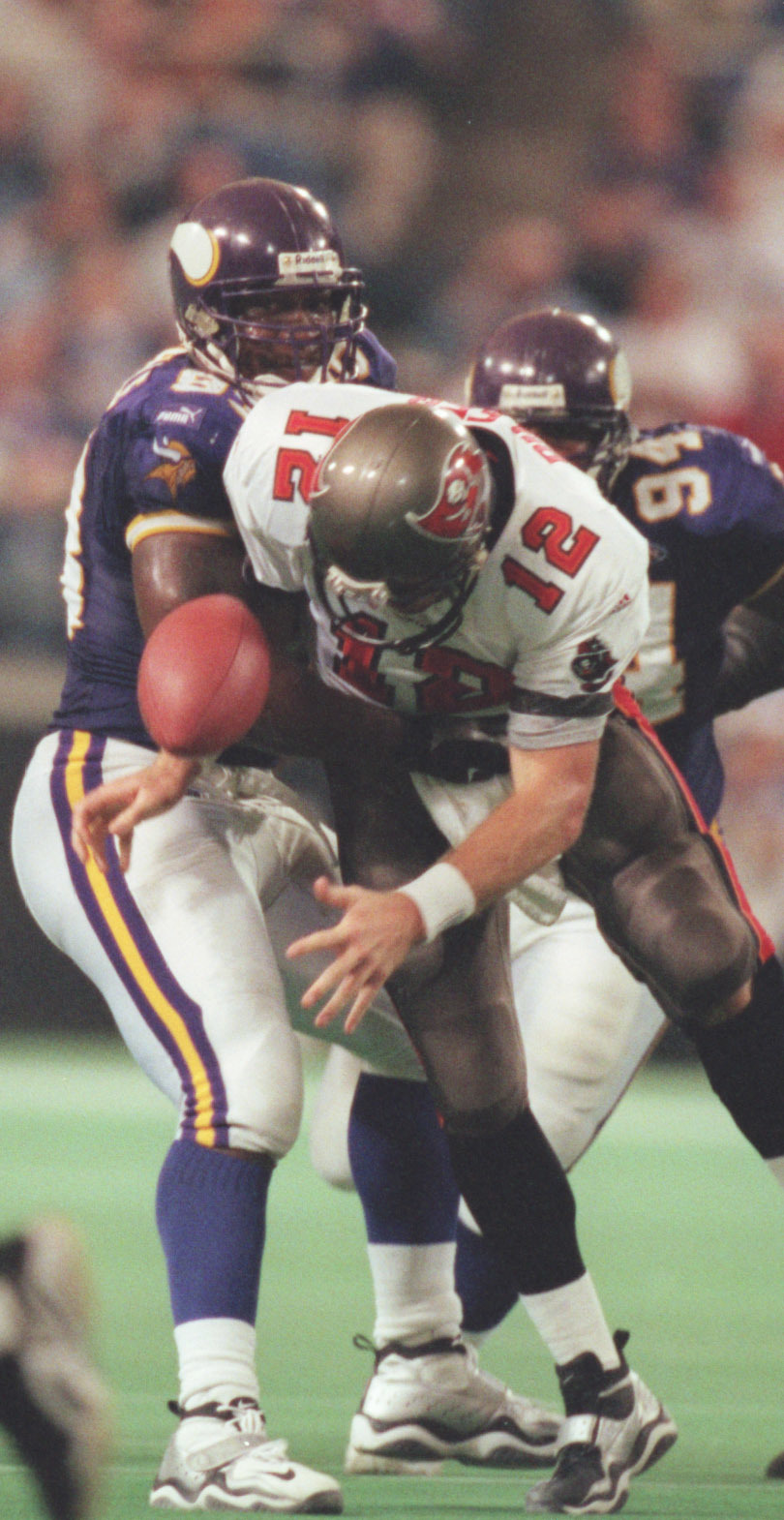 Oct. 3	-Tampa Bay - Minnesota Vikings -- Minneapolis Mn, Sunday 10/3/99 Vikings vs Tampa----Vikings John Randle knocks the ball away from Tamp Bay quarter back Trent Dilfer early in the 4th quarter, Randle recovered the fumble.