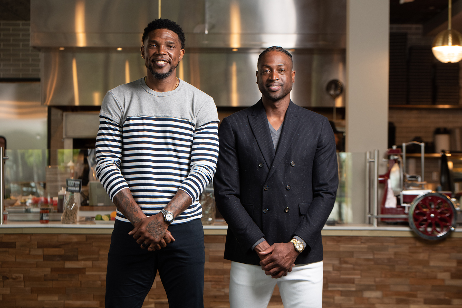 Picture of Dwyane Wade and Udonis Haslem standing in their restaurant