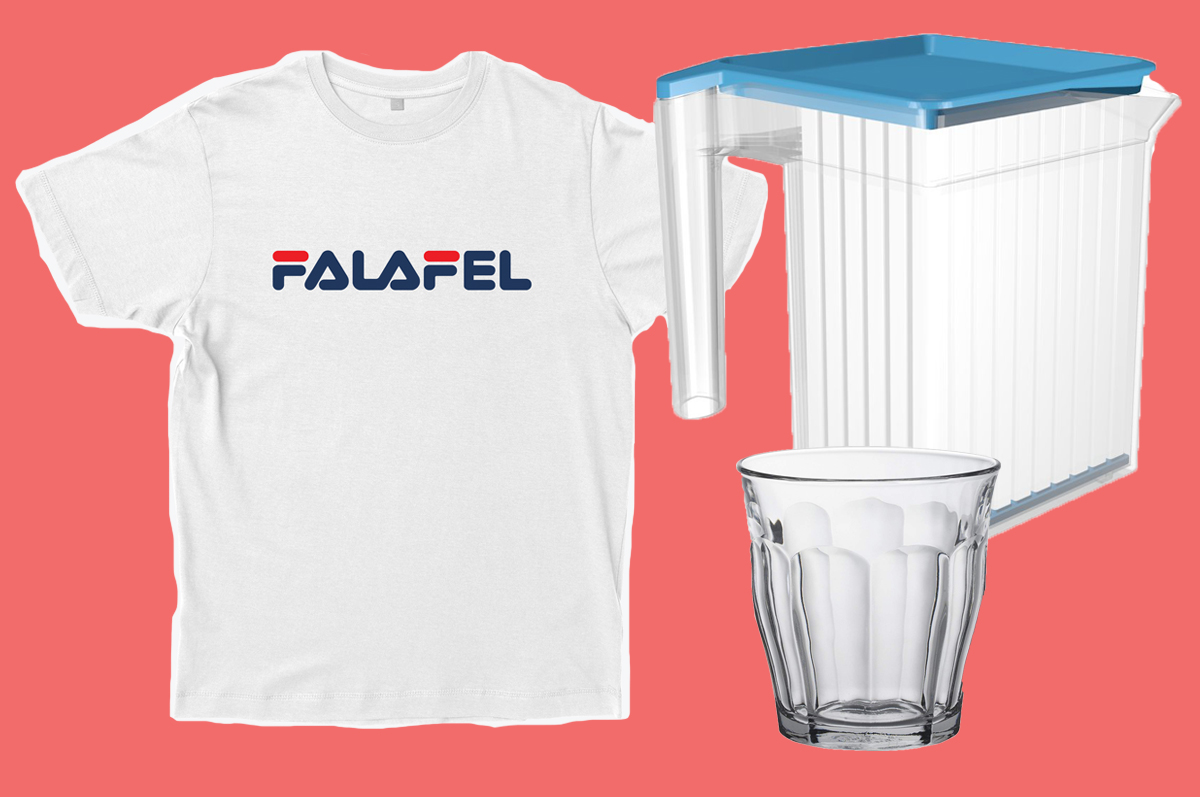 "A white T-shirt that says ""Falafel"" in Fila-esque print, a clear plastic pitcher, and a clear squat ribbed drinking glass, all pasted on a pink background"