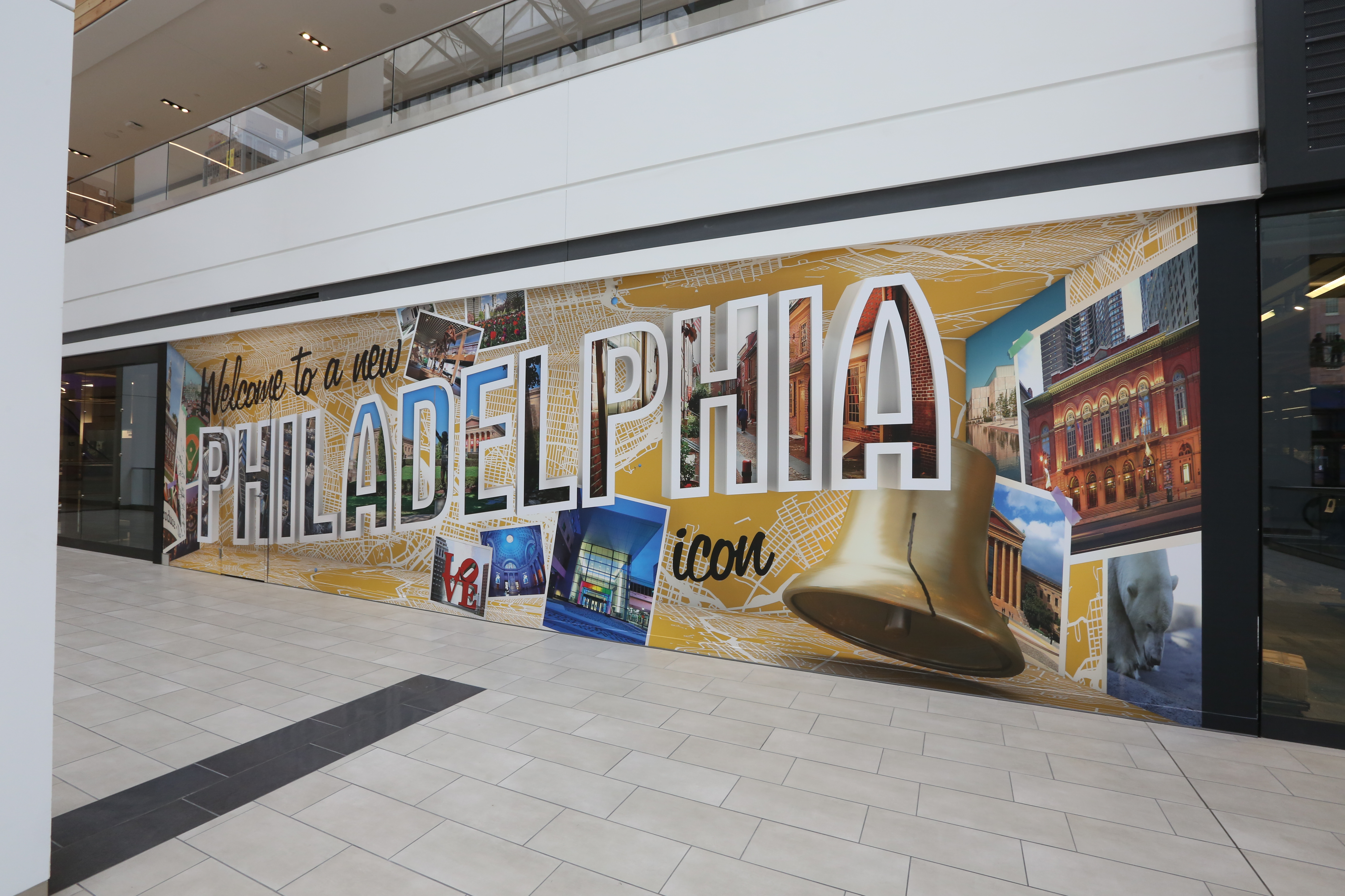 a mural that says philadelphia and has philly items