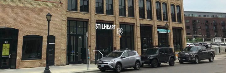 The exterior of what will be Stilheart, brick building, large windows
