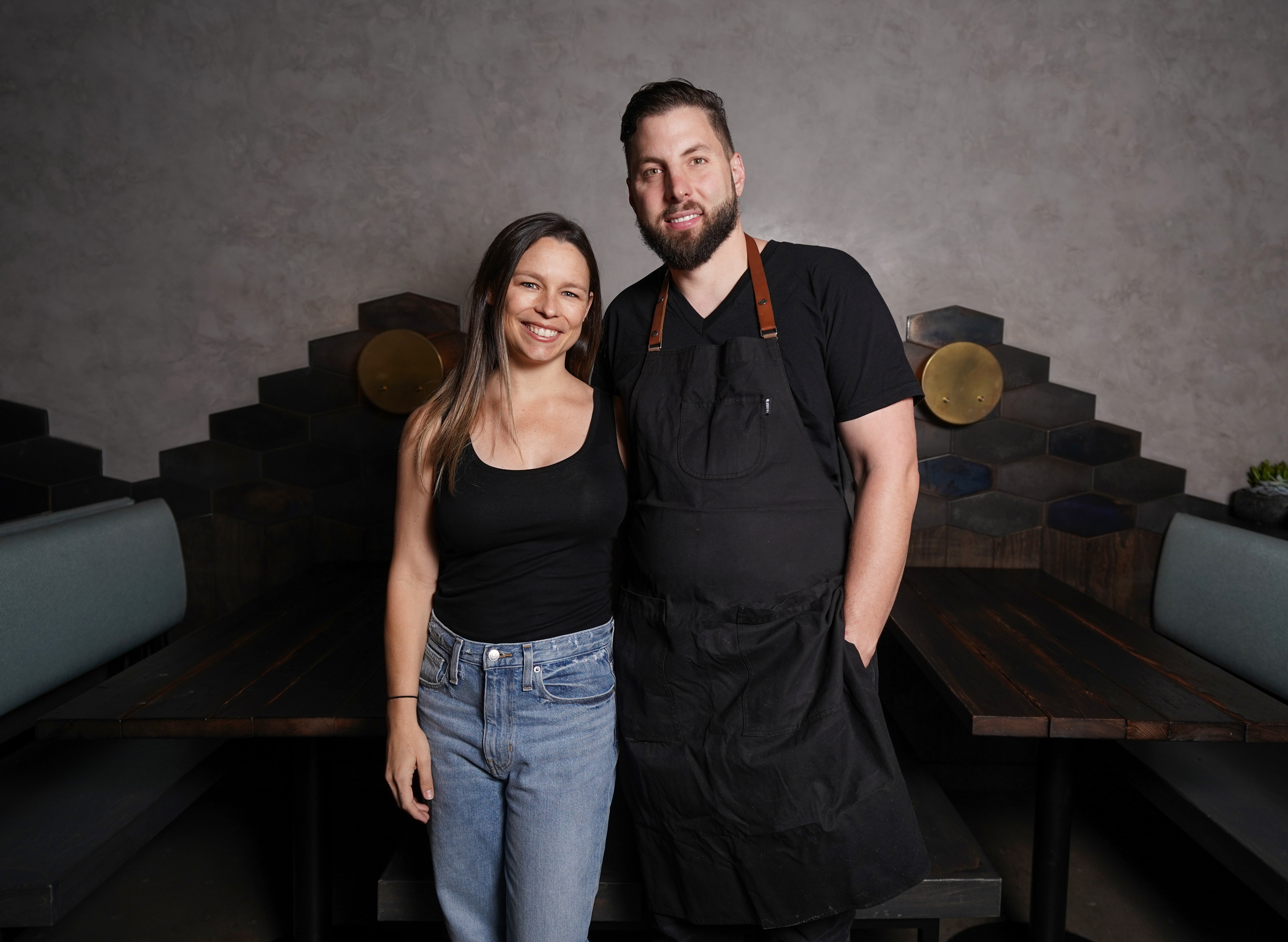 Caitlin and Daniel Cutler standing in the dining room of their LA restaurant Ronan.