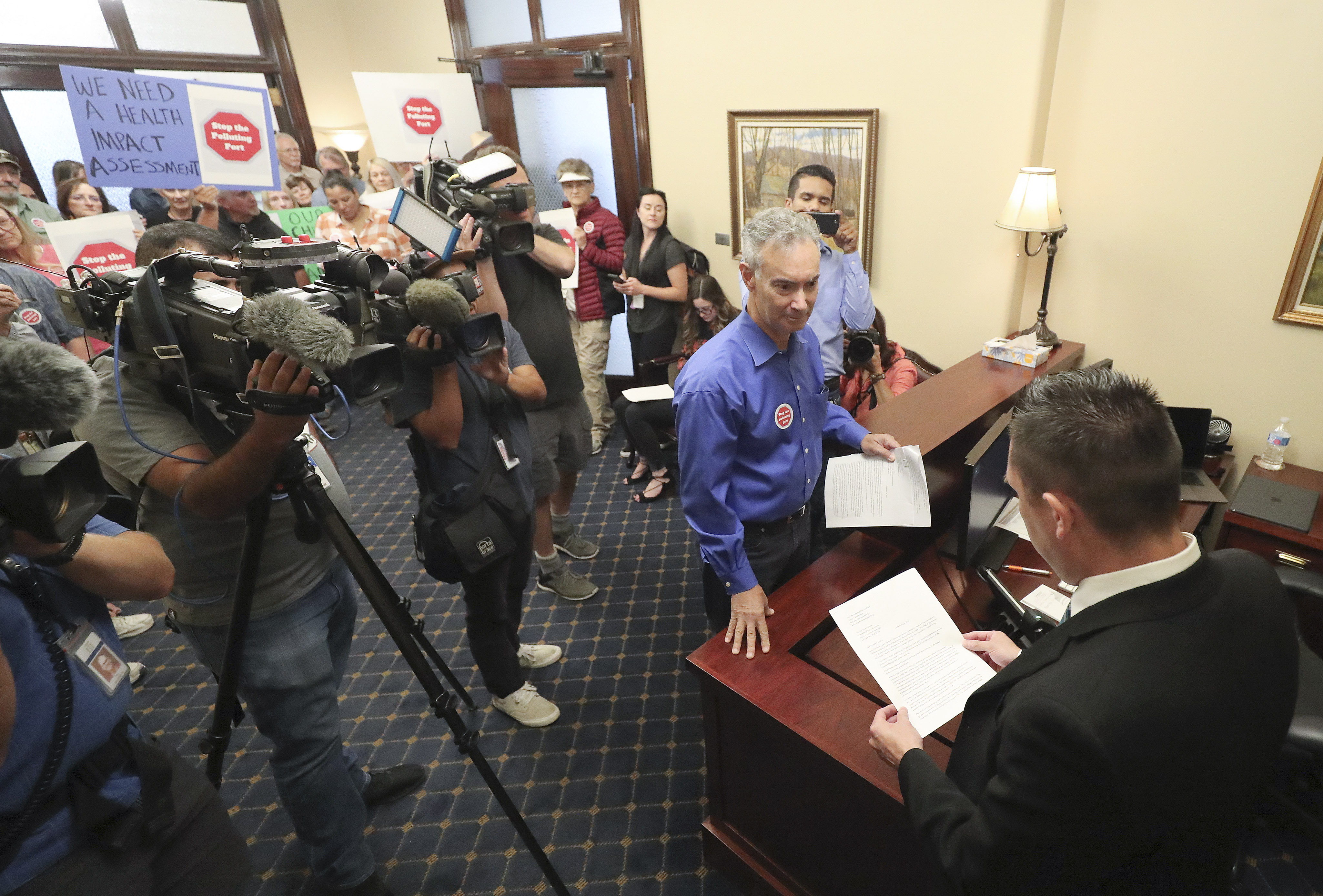 David Scheer and other members of the Stop the Polluting Port Coalition deliver a letterto Senate chief of staff Mark Thomasafter holding a rally at the Capitol in Salt Lake City on Wednesday, Sept. 18, 2019. The letter asked for legislative support and funding of a health impact assessment of the proposed Utah Inland Port.
