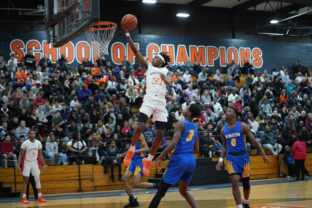 Young's DJ Steward (21) floats to the basket for two points.