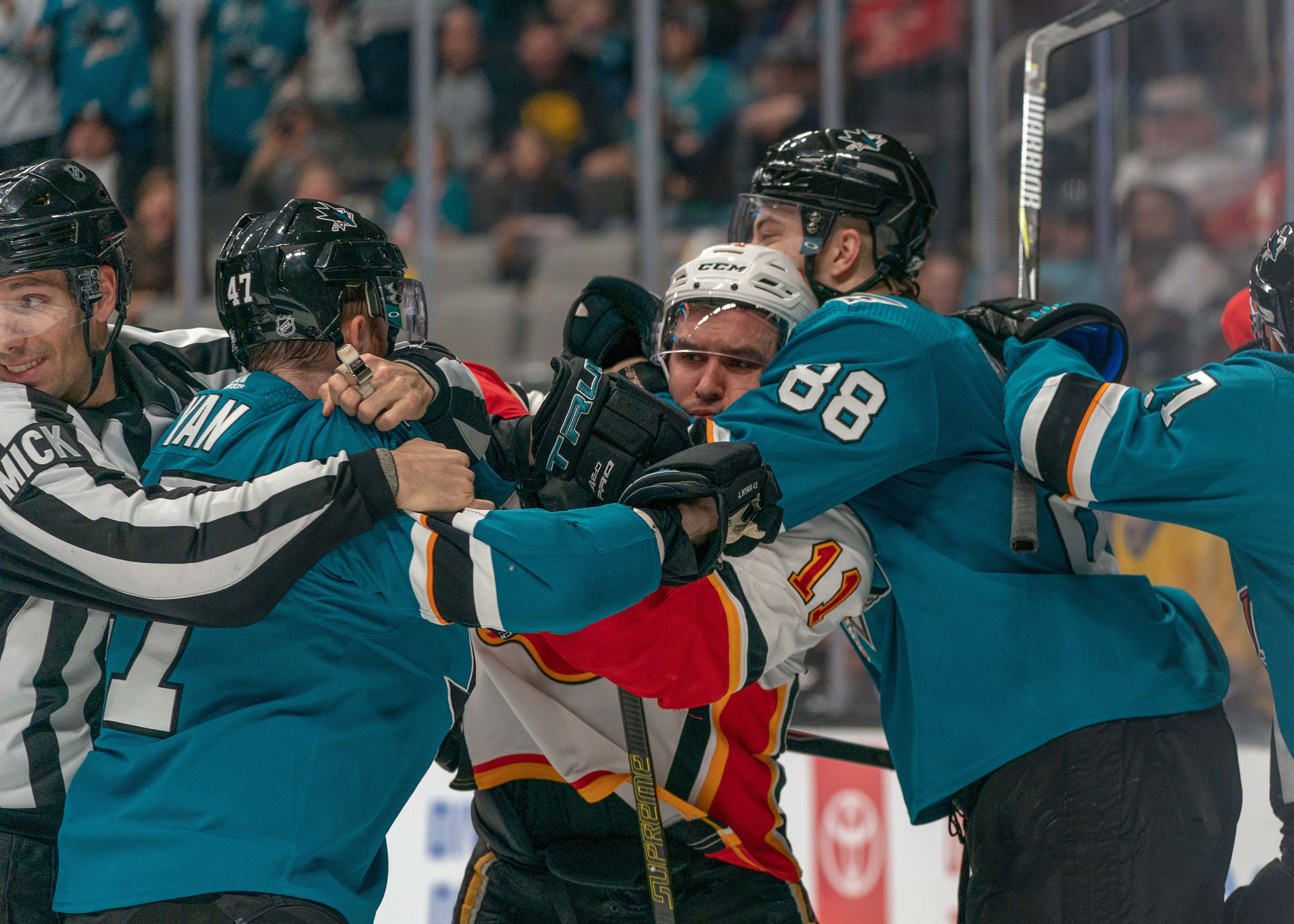 Mar 31, 2019; San Jose, CA, USA; San Jose Sharks defenseman Brent Burns (88) attempt to restrain Calgary Flames center Mikael Backlund (11) during the fight during the third period at SAP Center at San Jose. Mandatory Credit: Neville E. Guard