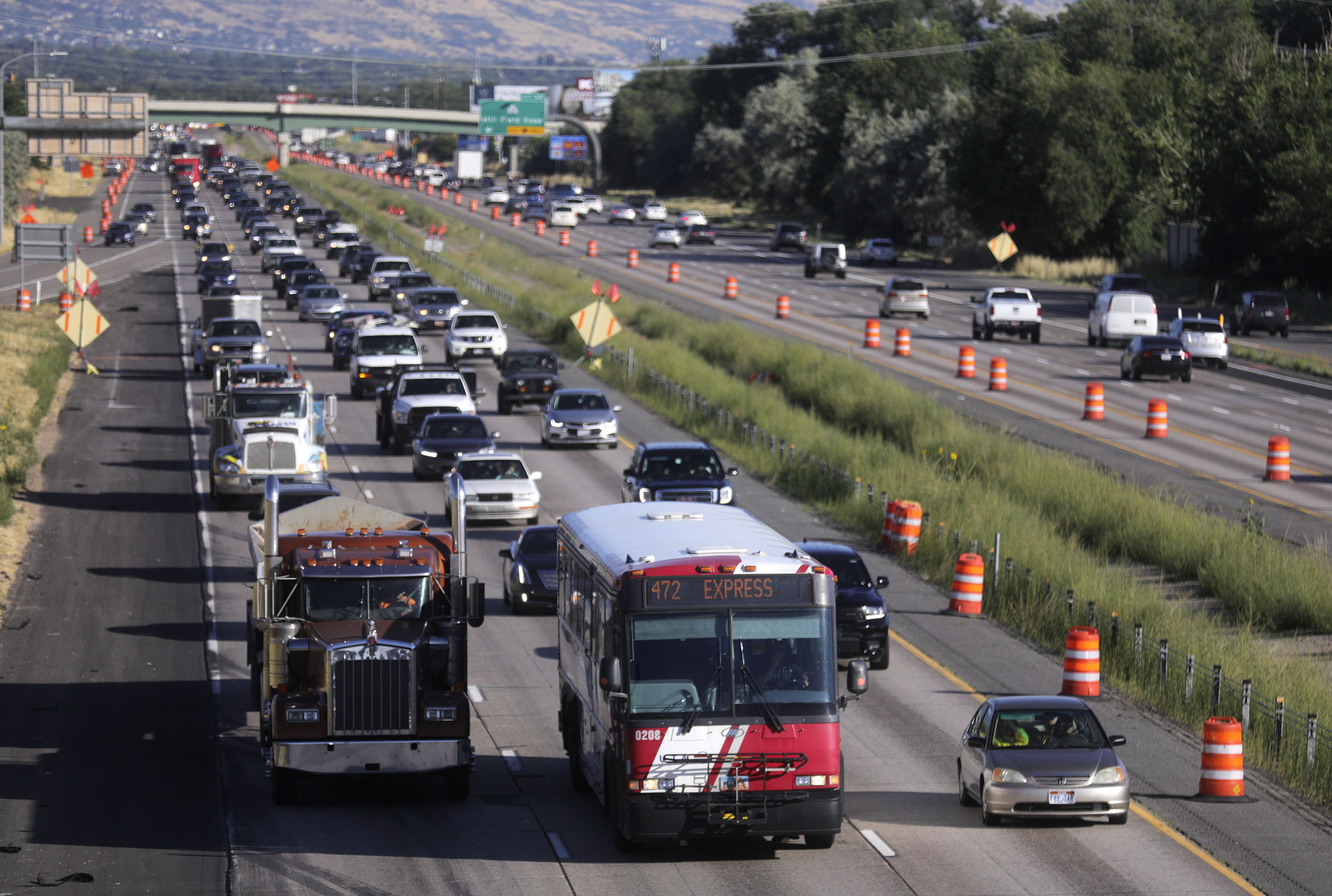 FILE - Northbound traffic moves slowly during rush hour on I-15 near Antelope Drive in Layton on Wednesday, Aug. 14, 2019.