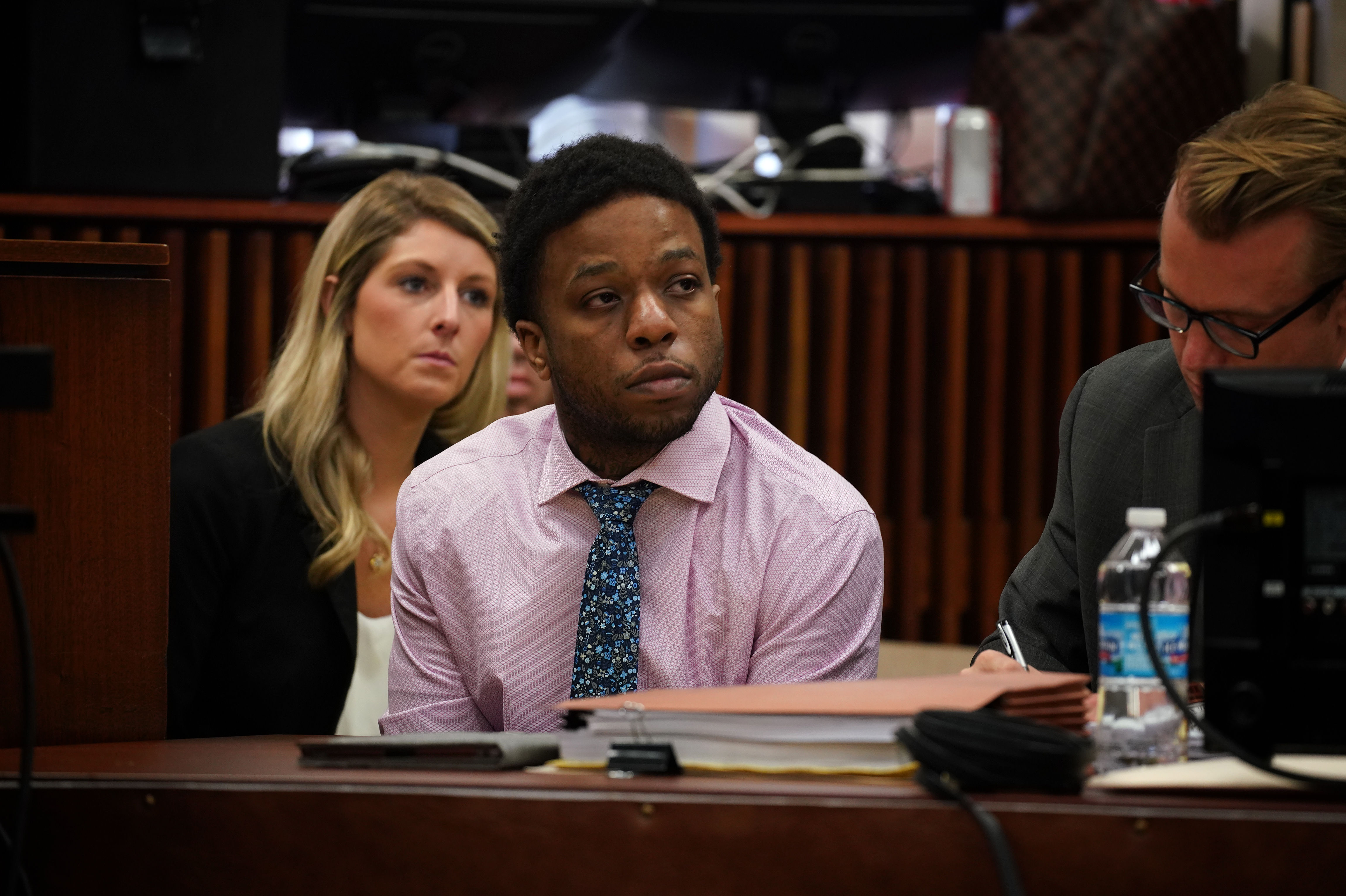 Corey Morgan, on trial for the murder of Tyshawn Lee, sits beside his lawyers Tuesday during opening statements at the Leighton Criminal Court Building.