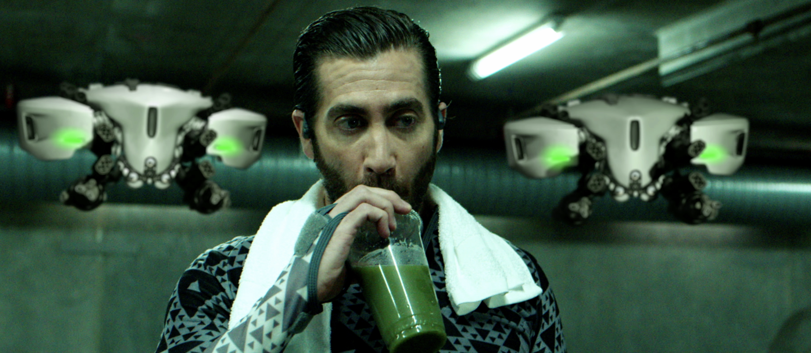Mysterio sips some green juice as droids hover behind him