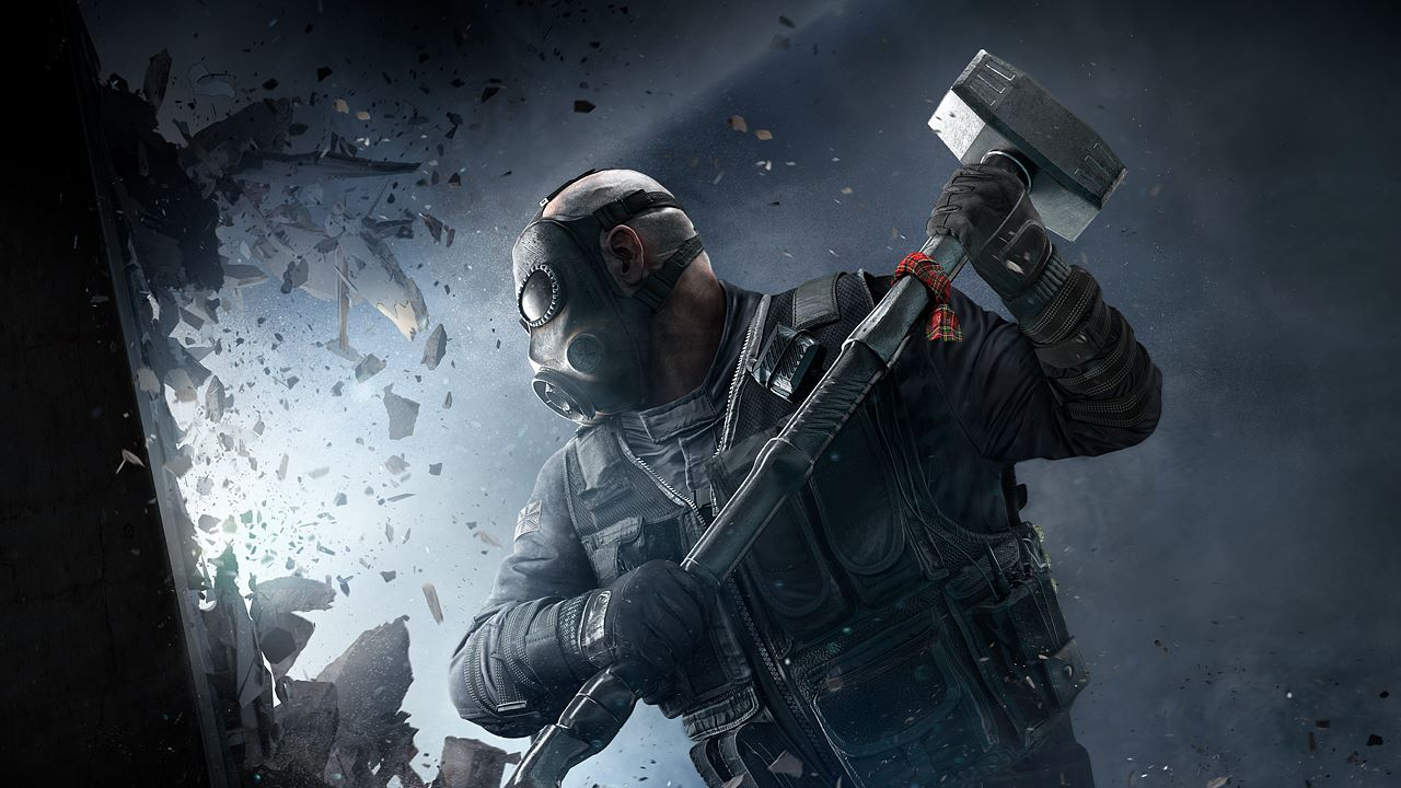 A man with a sledgehammer breaks down a wall in Rainbow Six Siege