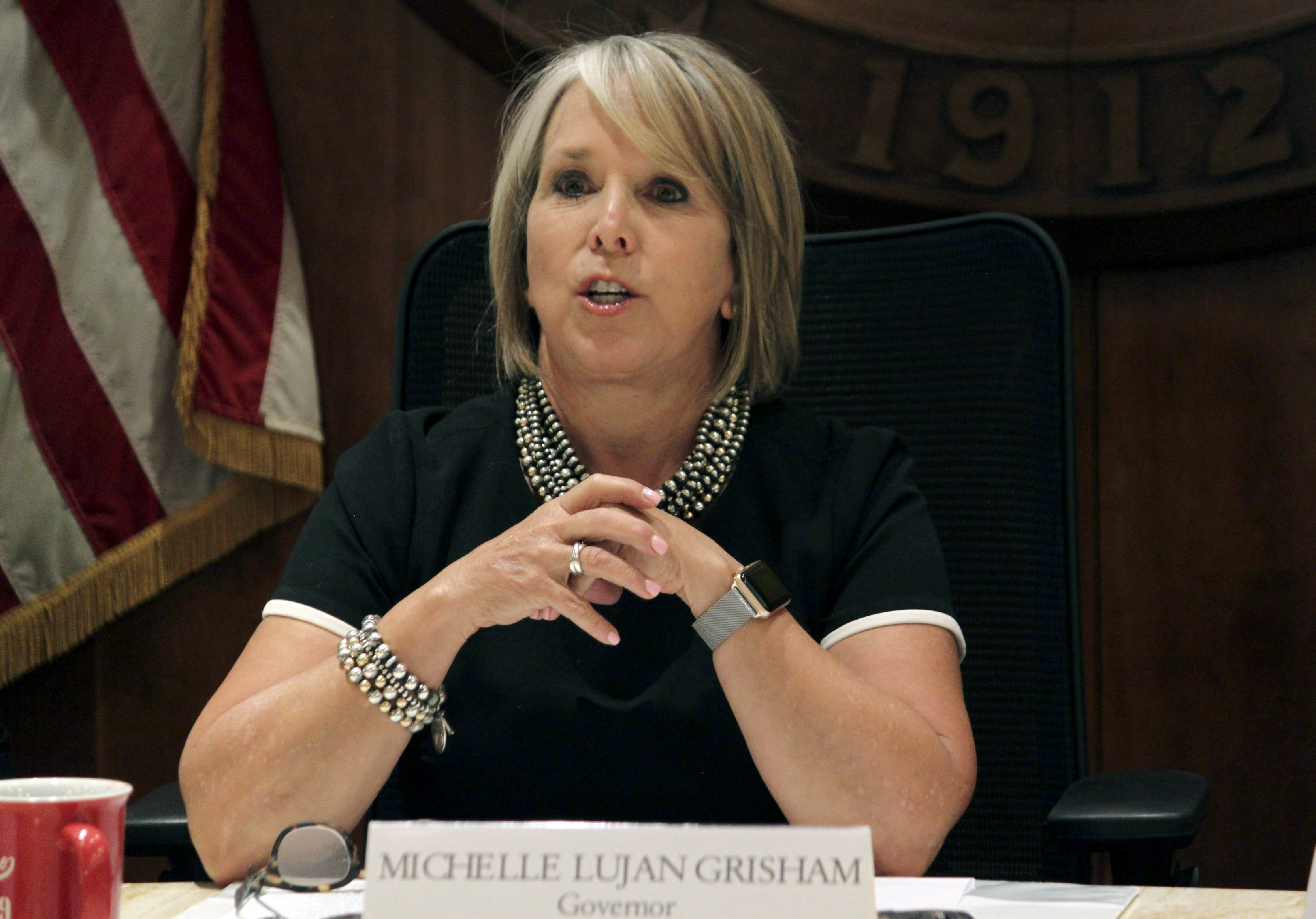In this July 9, 2019 file photo, New Mexico Gov. Michelle Lujan Grisham speaks during a news conference in Santa Fe, N.M.