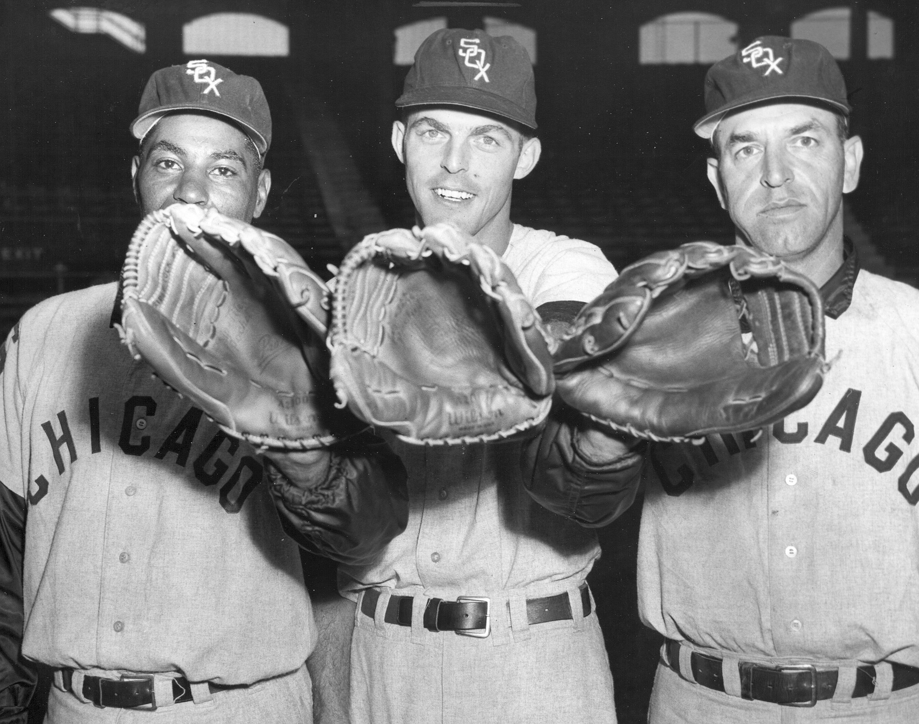 Three White Sox outfielders — Al Smith, Jim Landis and Jim Rivera —pose for a photo, left to right, at Comiskey Park in 1959.