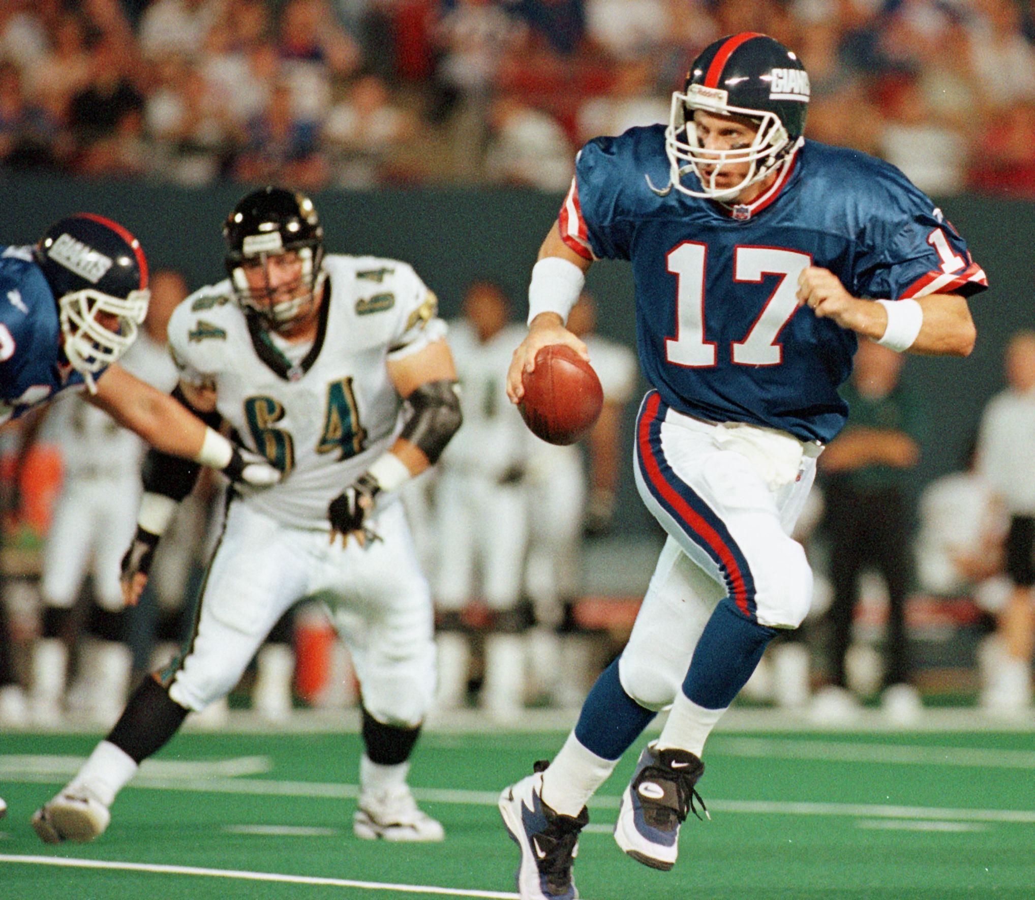 New York Giants quarterback Dave Brown (17) scramb