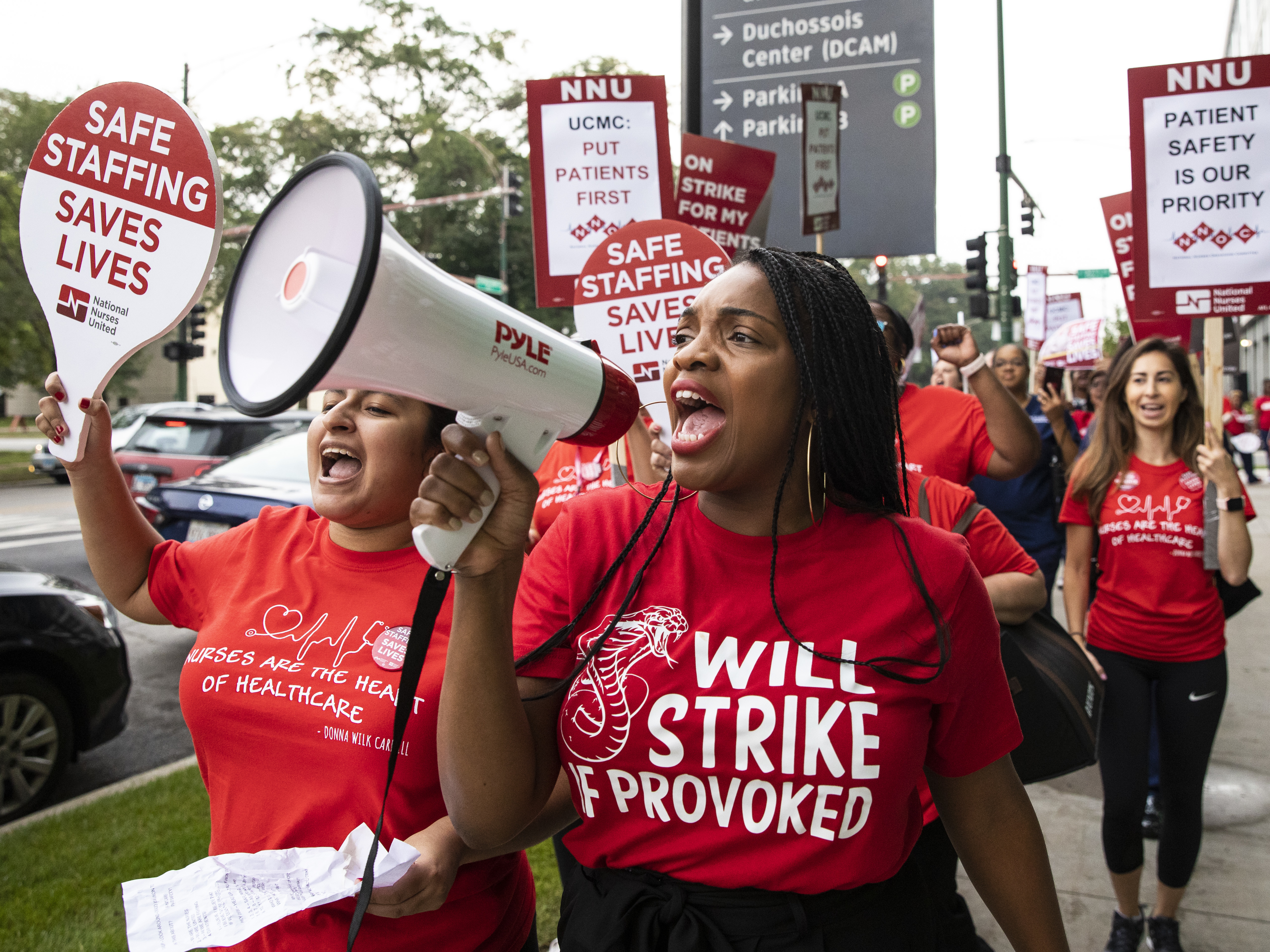 Tiffany Eubanks, a nurse in the cardiothoracic surgery department at the University of Chicago Medical Center, leads a chant as she and thousands of other nurses strike outside the South Side hospital, Friday morning, Sept. 20, 2019.