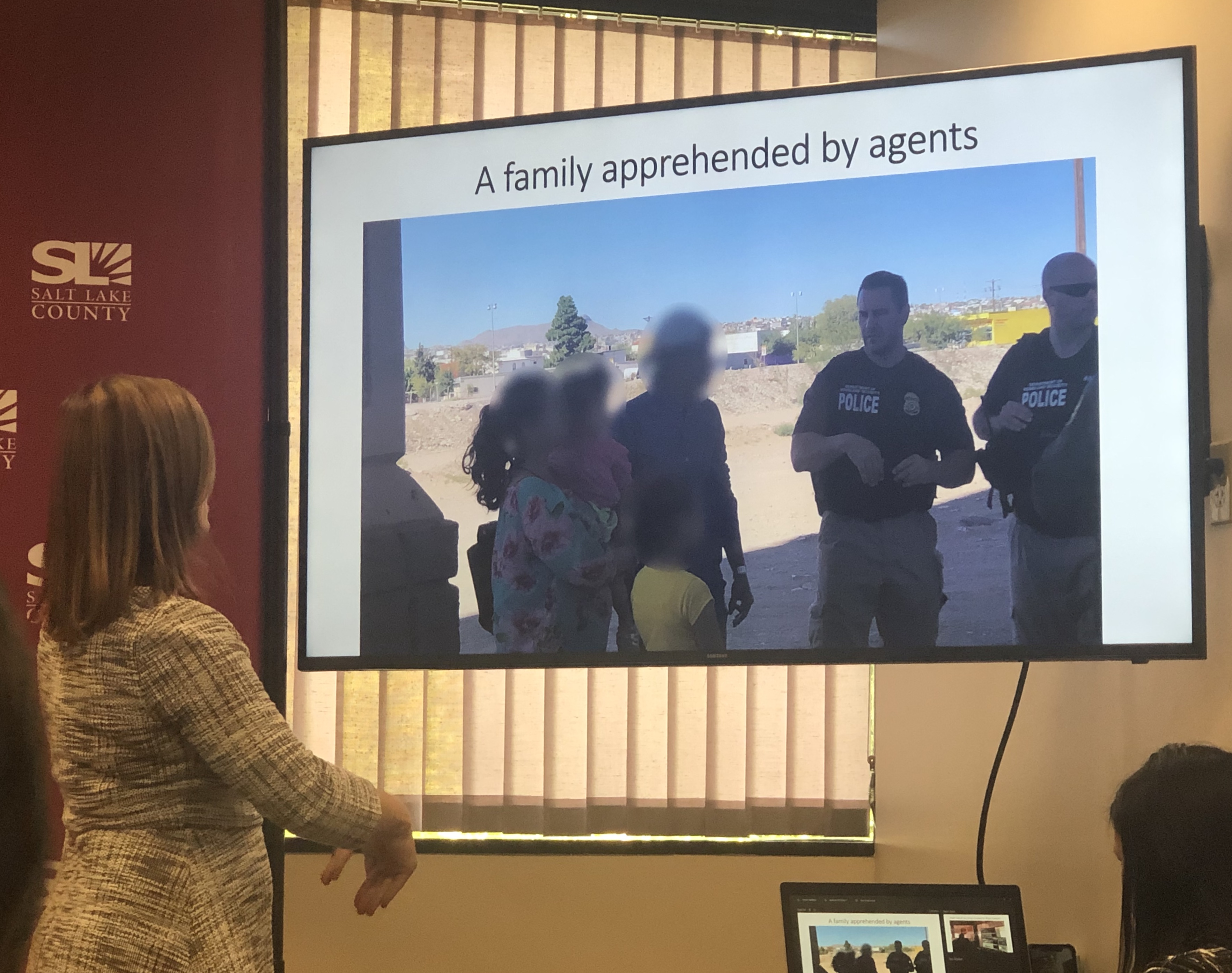 Salt Lake County Mayor Jenny Wilson shows members of the media a picture she took of a family being apprehended at the border by agents during a tour she took of the Paso Del Norte Port of Entry and Border Patrol Satellite Processing Center in El Paso County, Texas, with members of the National Association of Counties on Tuesday, September 17, 2019. Wilson said she chose to blur the faces of the family for privacy during a news conference Thursday, Sept. 19, 2019.