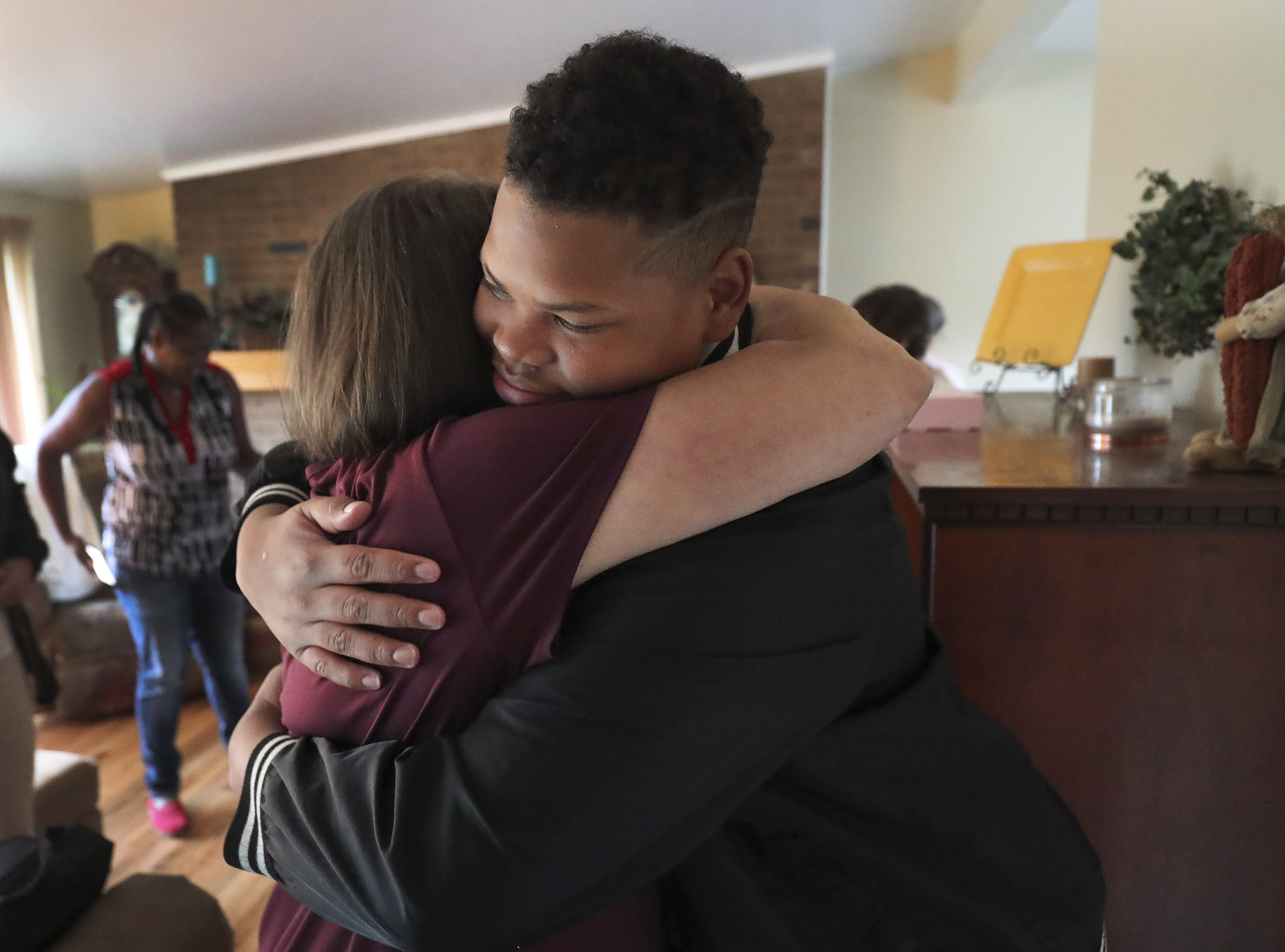 Damian Jackson, right, hugs Terry Lemmon in Holladay on Thursday, Sept. 19, 2019. Jackson, a Highland High School student, accidentally left a dance invitation at Lemmon's house intended for fellow student.