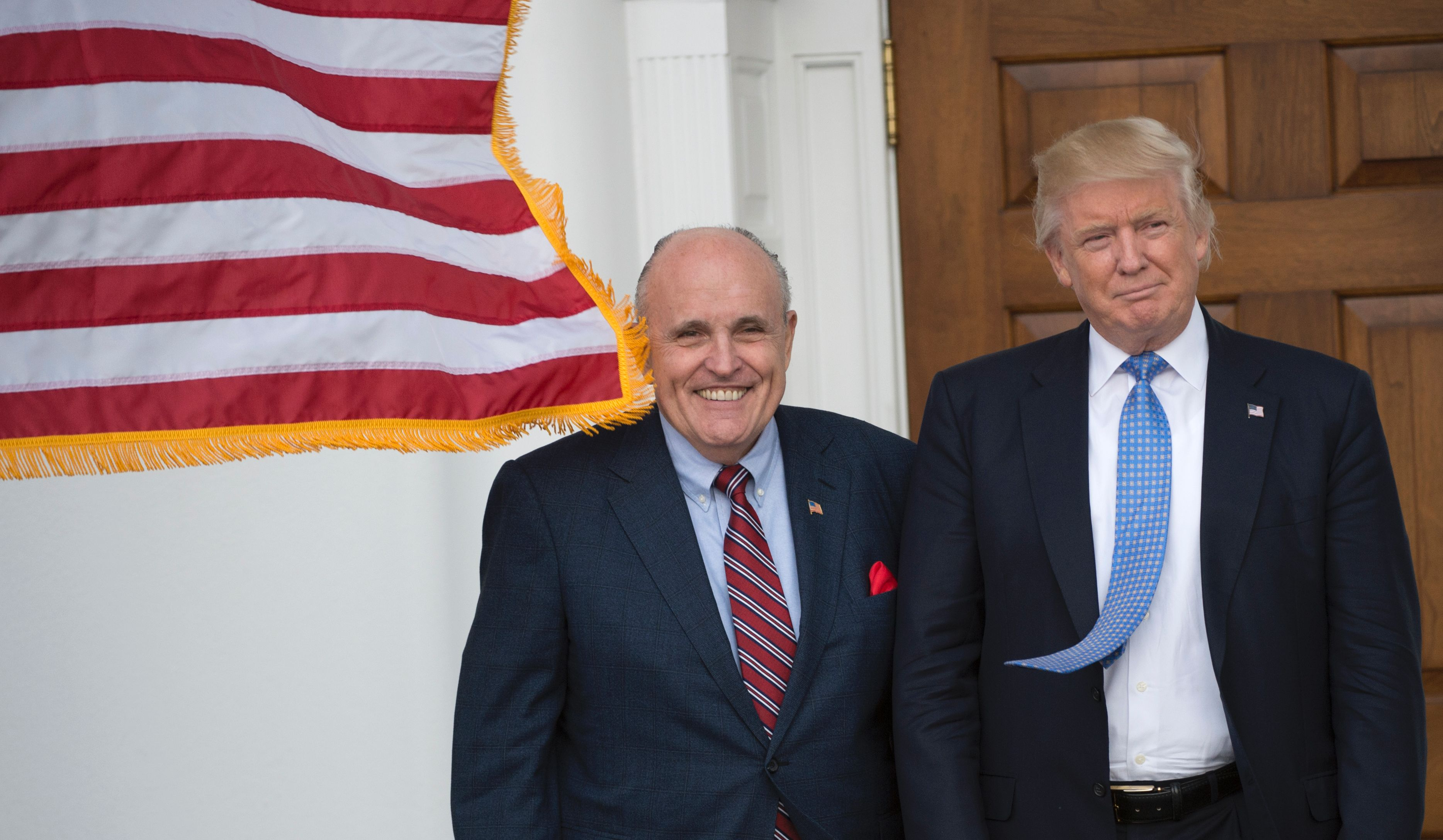 President-elect Donald Trump meets with former New York City Mayor Rudy Giuliani at the clubhouse of Trump National Golf Club November 20, 2016 in Bedminster, New Jersey.