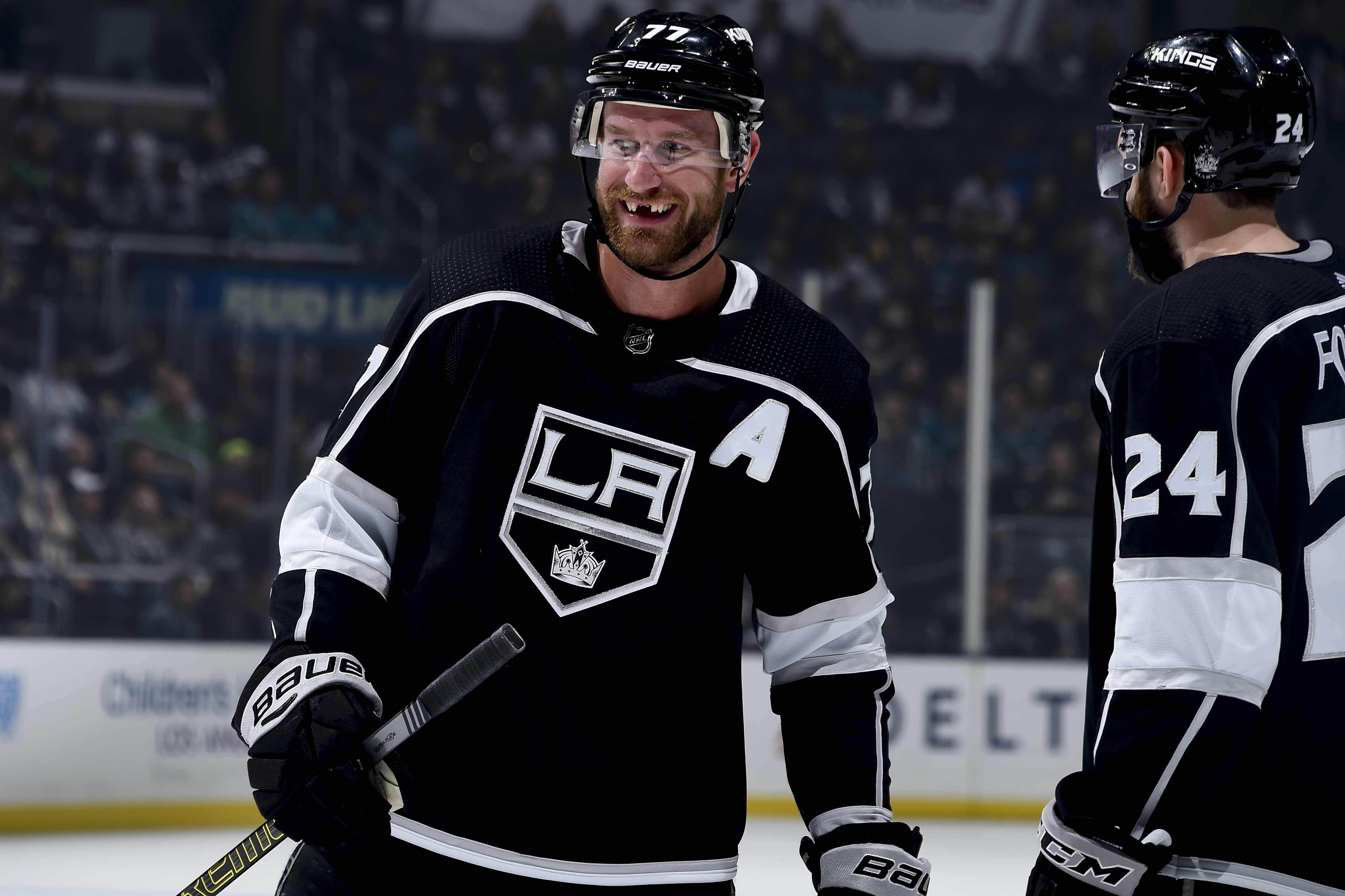 Jeff Carter #77 of the Los Angeles Kings smiles while waiting for play to resume during the first period of the game against the San Jose Sharks at STAPLES Center on March 21, 2019 in Los Angeles, California.