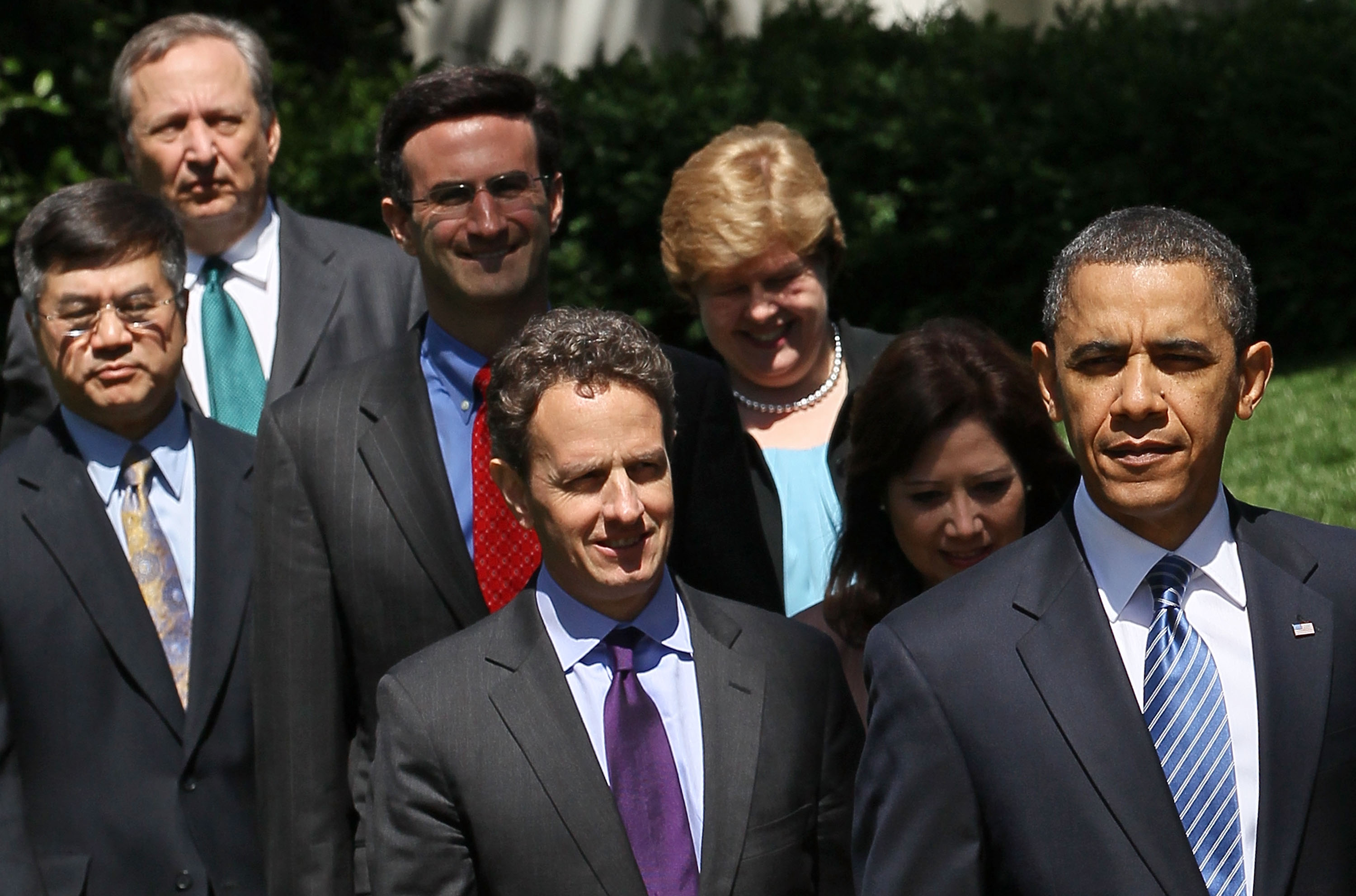 A 2010 picture of President Obama walking with his six-person economic team behind him.