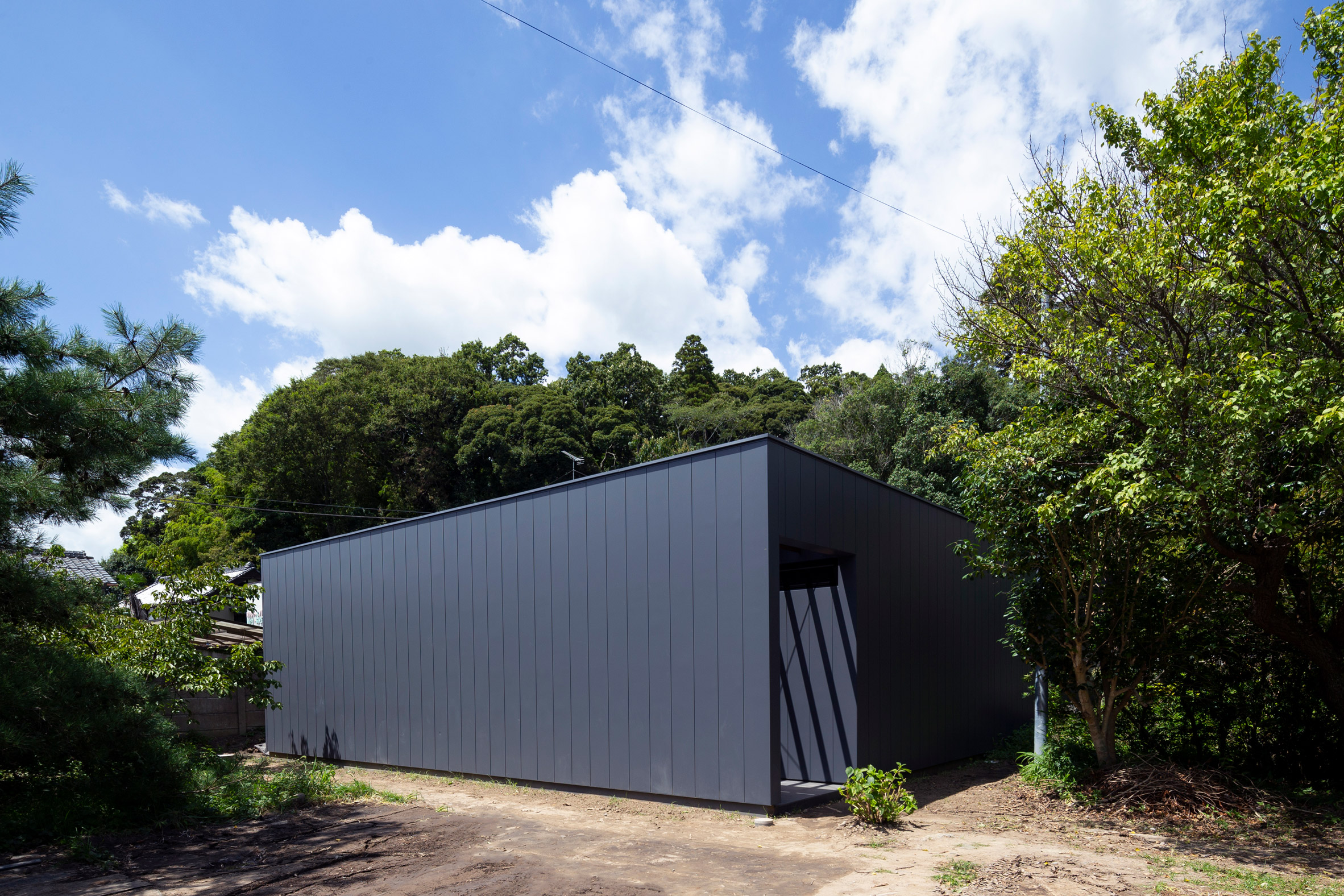 Moody all-black house hides a calm courtyard