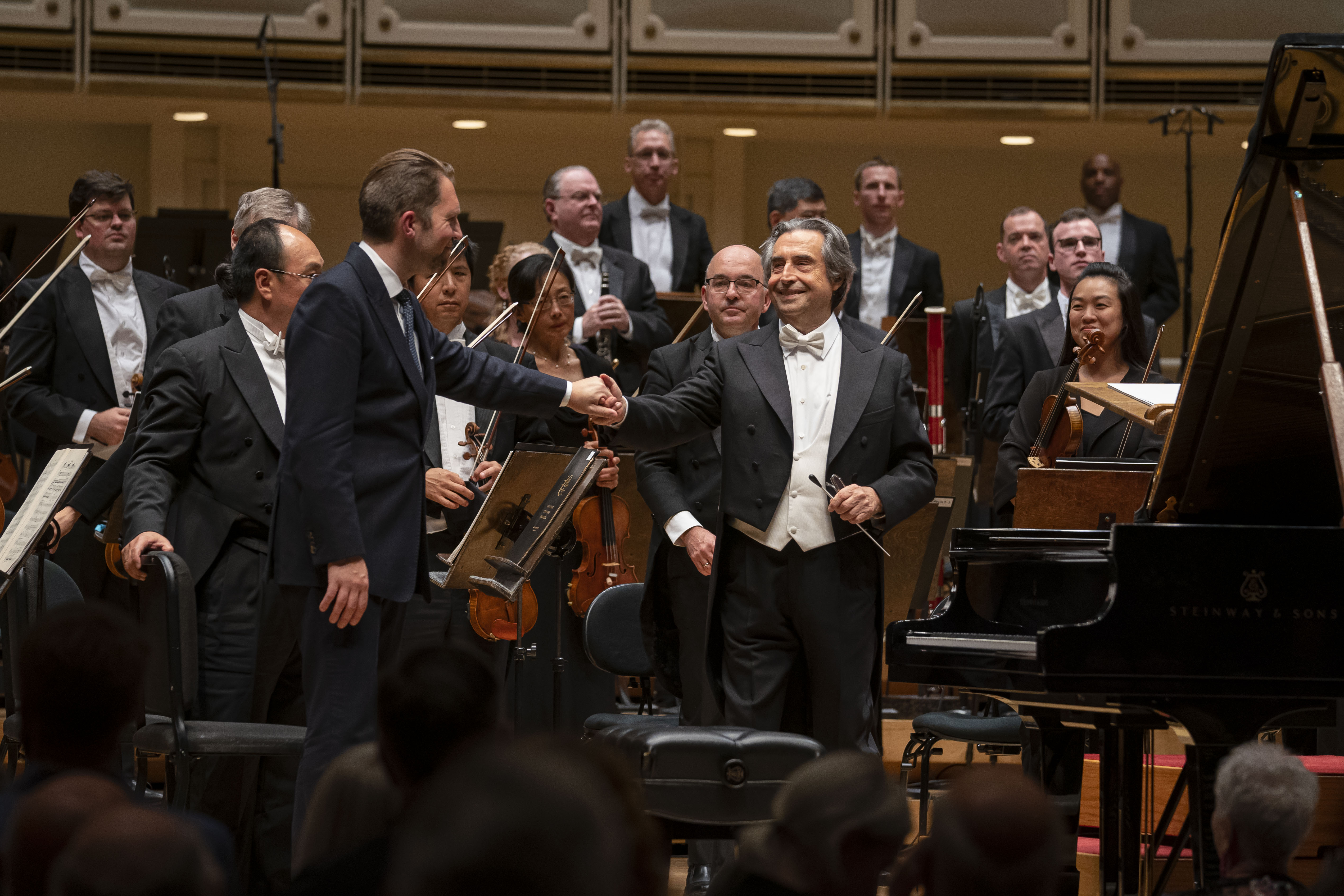 Leif Ove Andsnes and Riccardo Muti congratulate each other following their performance of Grieg's Piano Concerto with the Chicago Symphony Orchestra Thursday night in Orchestra Hall.