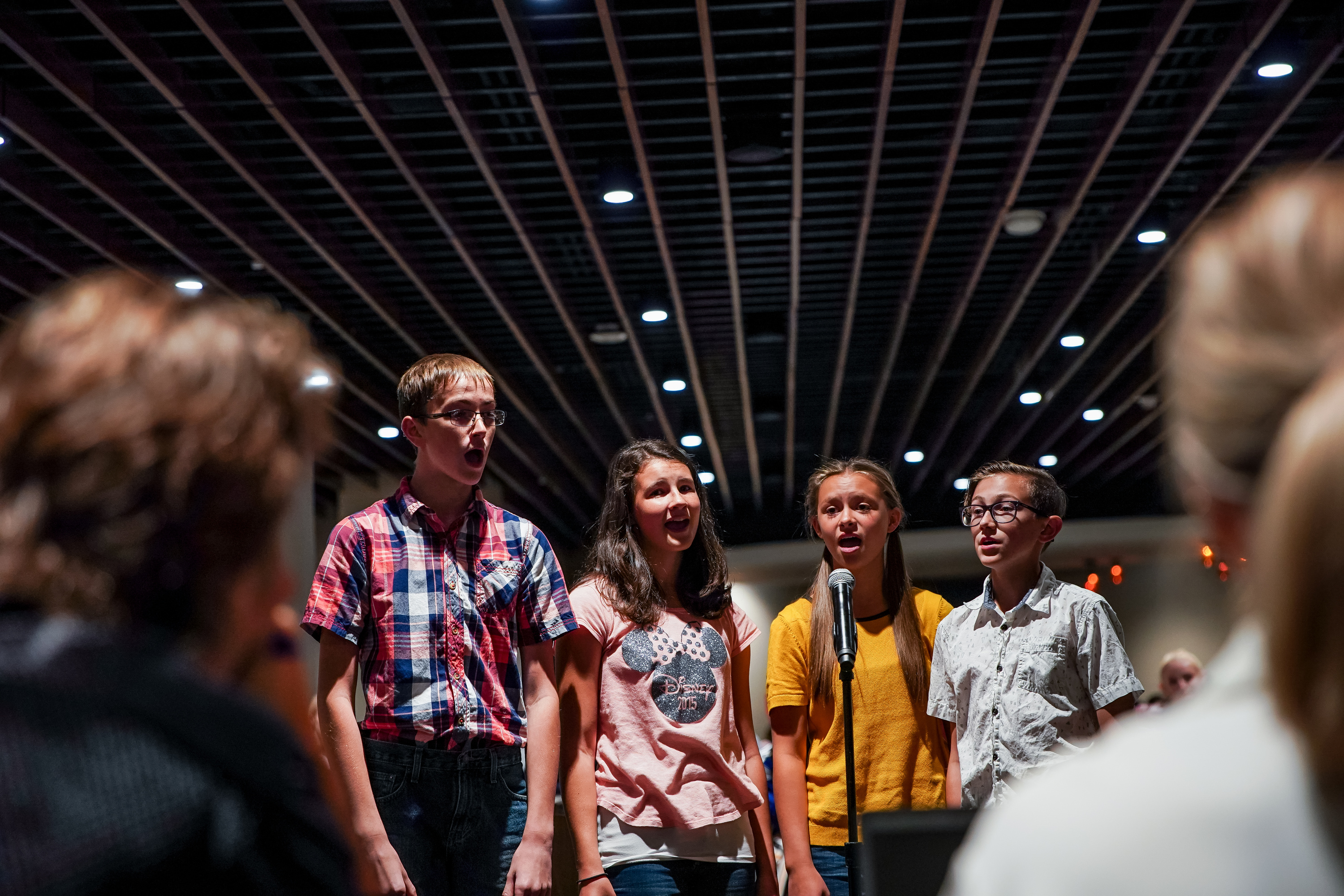 A.J. Stalker, 13, Katelyn Rowley, 12, Olivia Grover, 12, and Davy Kynoch, 14, of St. Anthony, Idaho, audition to sing the national anthem during the upcoming Utah Jazz season at Vivint Smart Home Arena in Salt Lake City on Friday, Sept. 20, 2019.