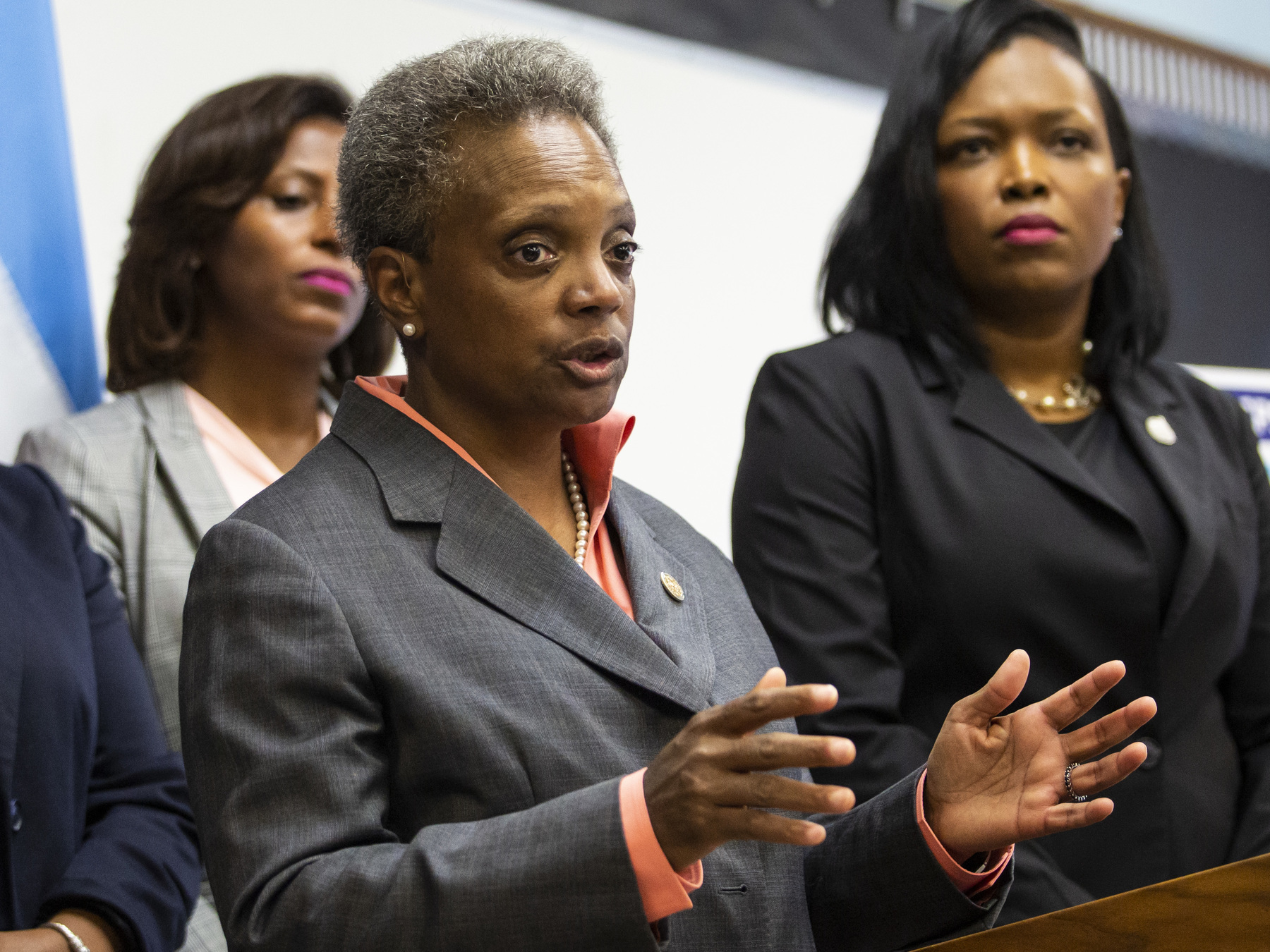 Chicago Public Schools Chief Education Officer LaTanya McDade (left) and CEO Janice Jackson (right) join Mayor Lori Lightfoot as she speaks about the Chicago Teachers Union contract in August.