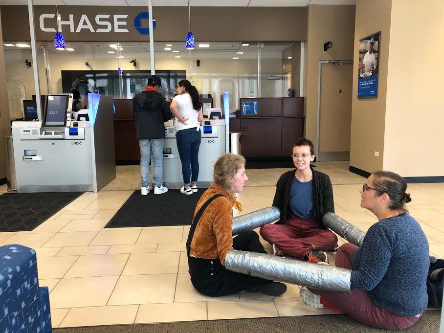 Protesters caused a downtown Chase Bank branch to close an hour earlier than scheduled September 21, 2019 in response to the banks alleged investment in fossil fuels.
