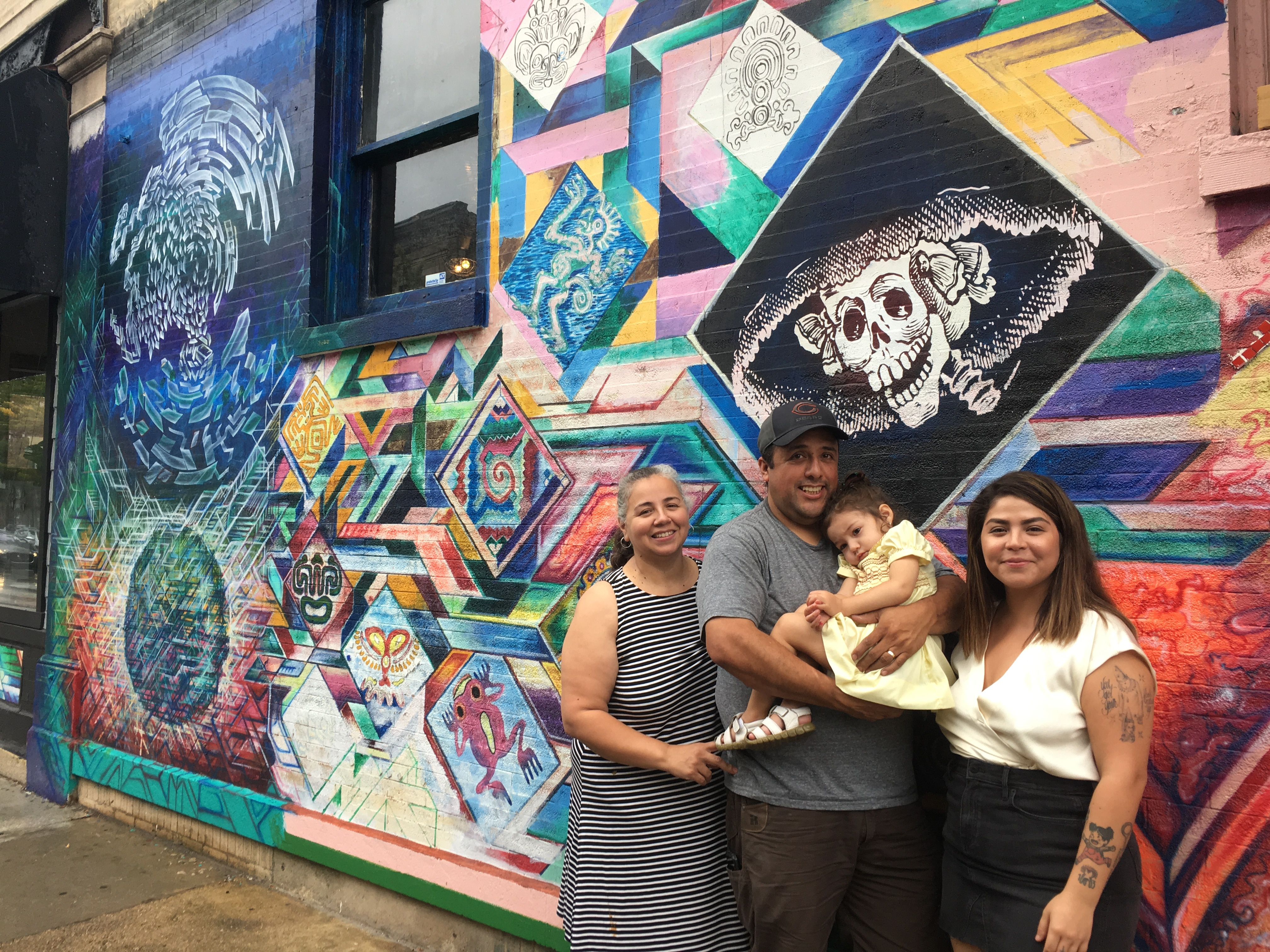 From the left: Diana Galicia, Salvador Corona, Olivia Cisneros, and Paola Zamora-Rojas stand outside La Catrina Café on Sunday. The family is selling the shop and plan on moving to Mexico in early October.