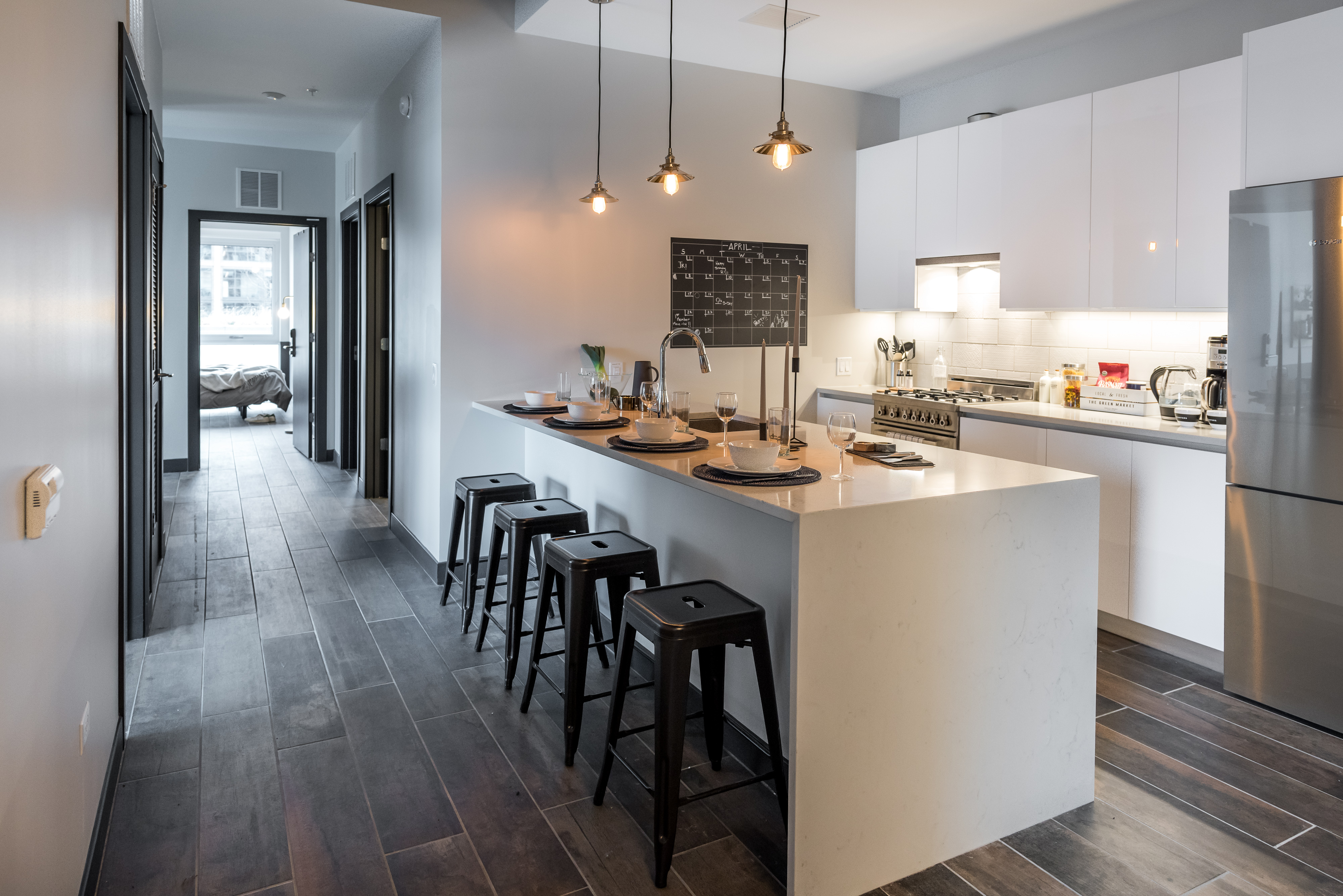 A sparse kitchen with modern appliances and an island.