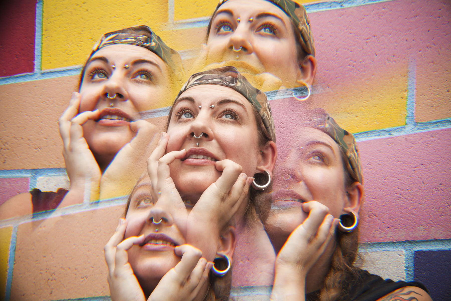 A kaleidoscope image of a woman holding her chin in her hands.