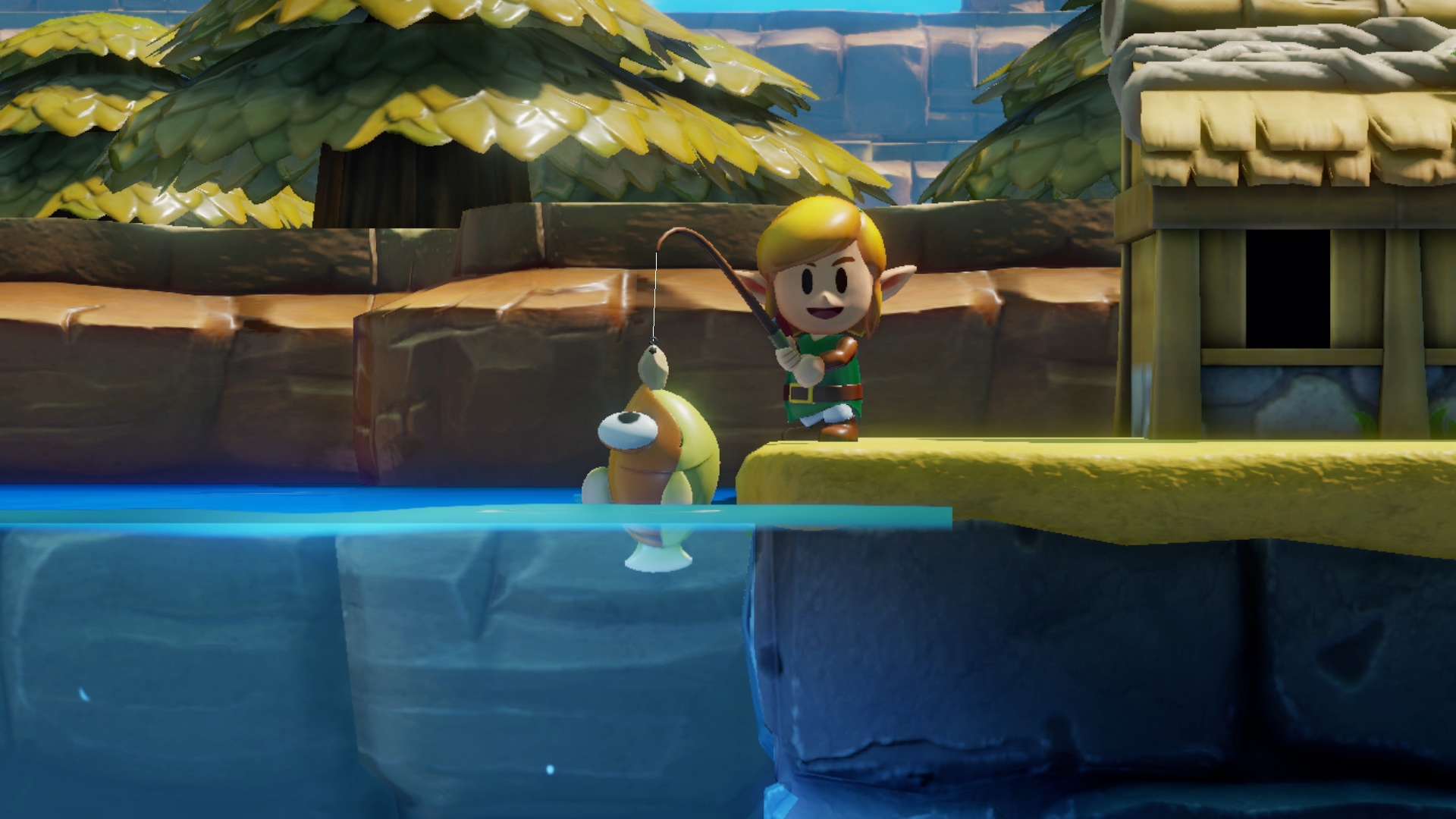 Link catches a fish in a screenshot from The Legend of Zelda: Link's Awakening (2019)