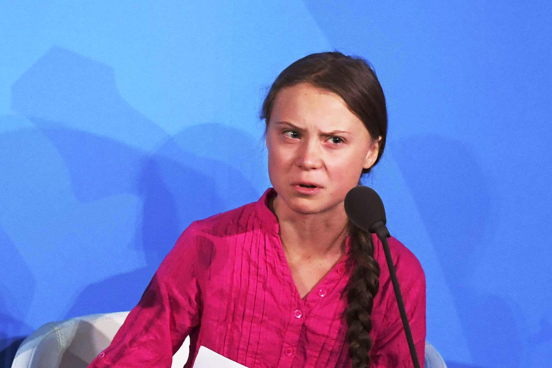 Swedish climate activist Greta Thunberg scowls from behind a microphone at the UN Climate Action Summit.