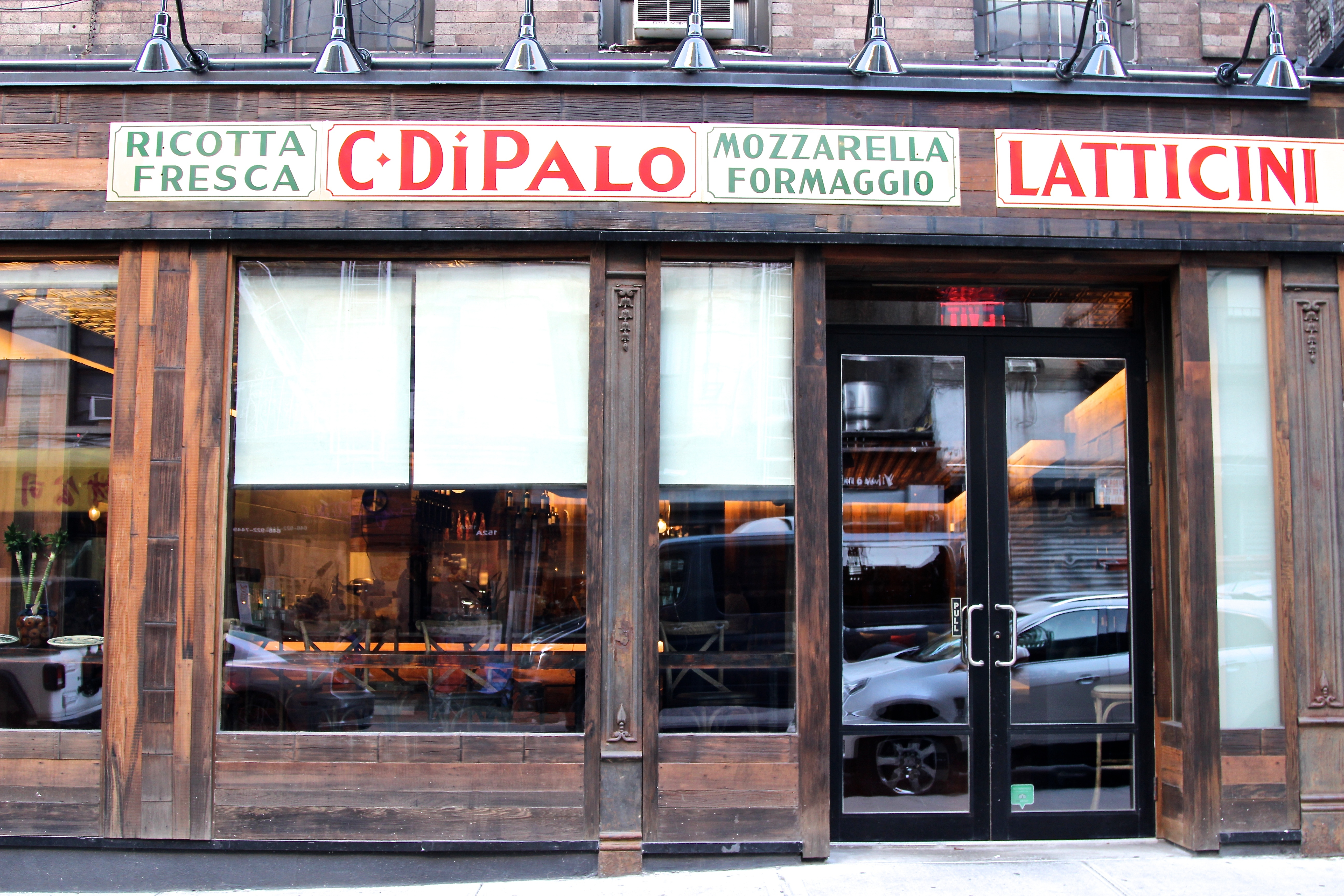 The exterior of a wine bar with the sign reading C. Di Palo in red letters