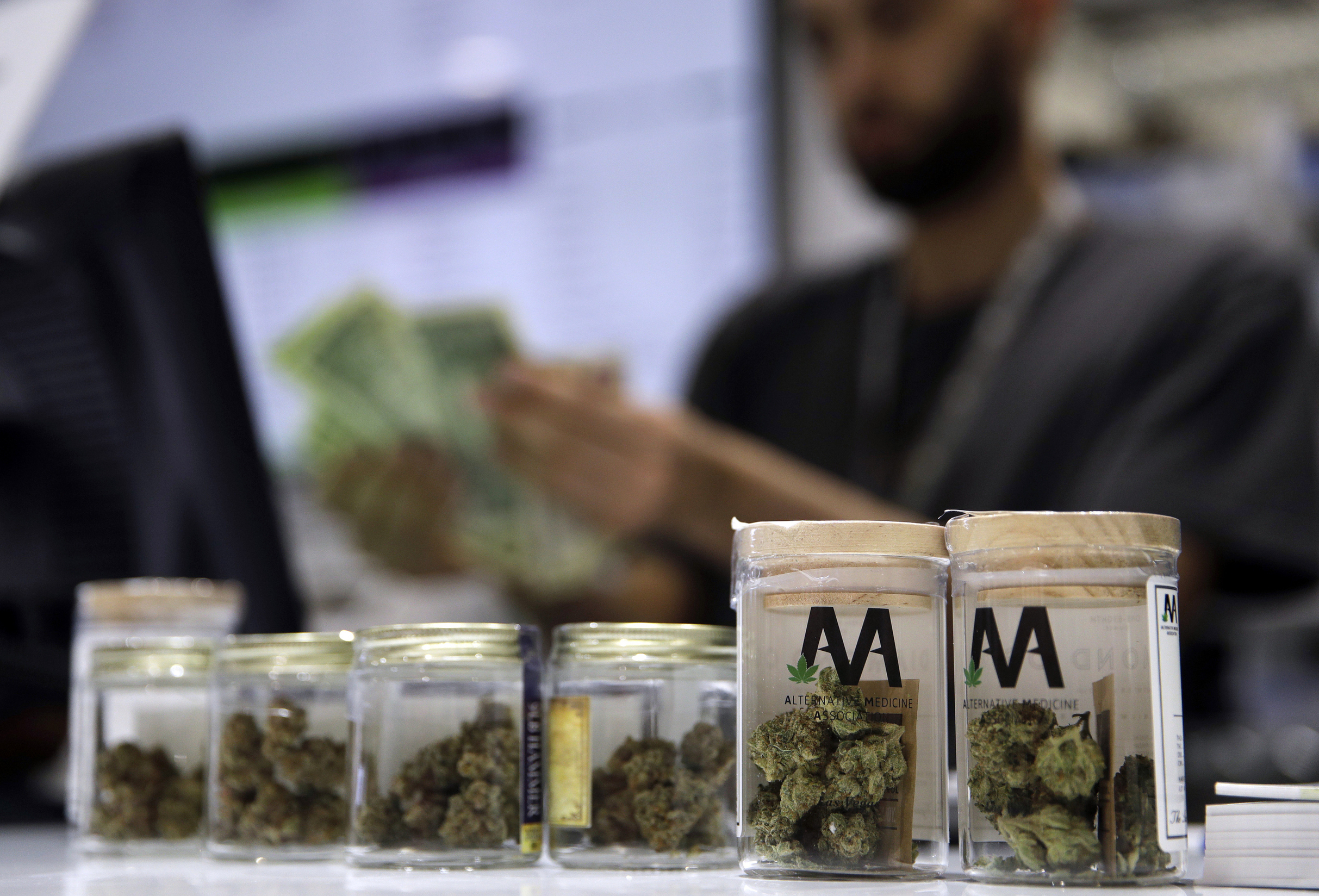 A cashier rings up a marijuana sale at a cannabis dispensary in Las Vegas.