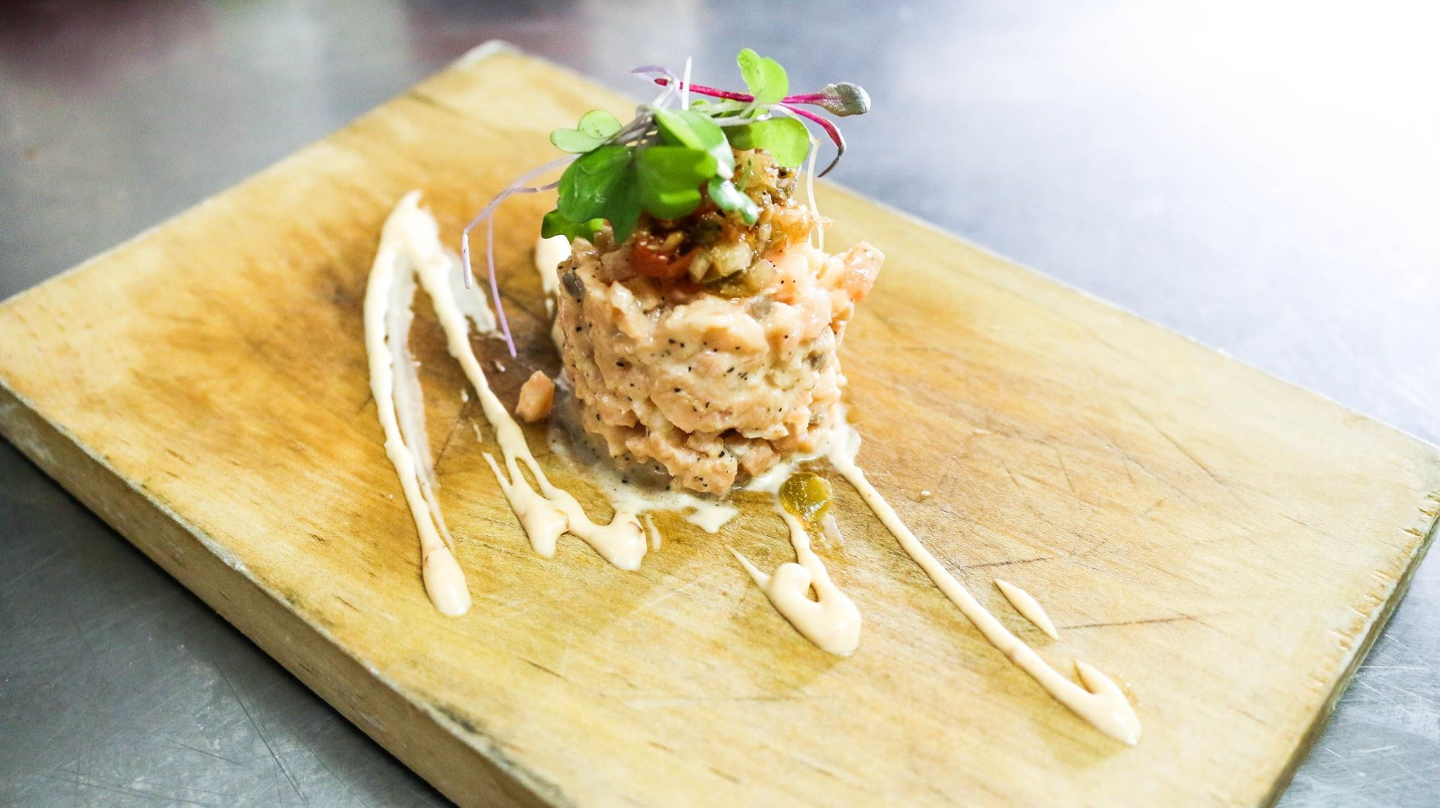 Salmon tartare on a wooden board